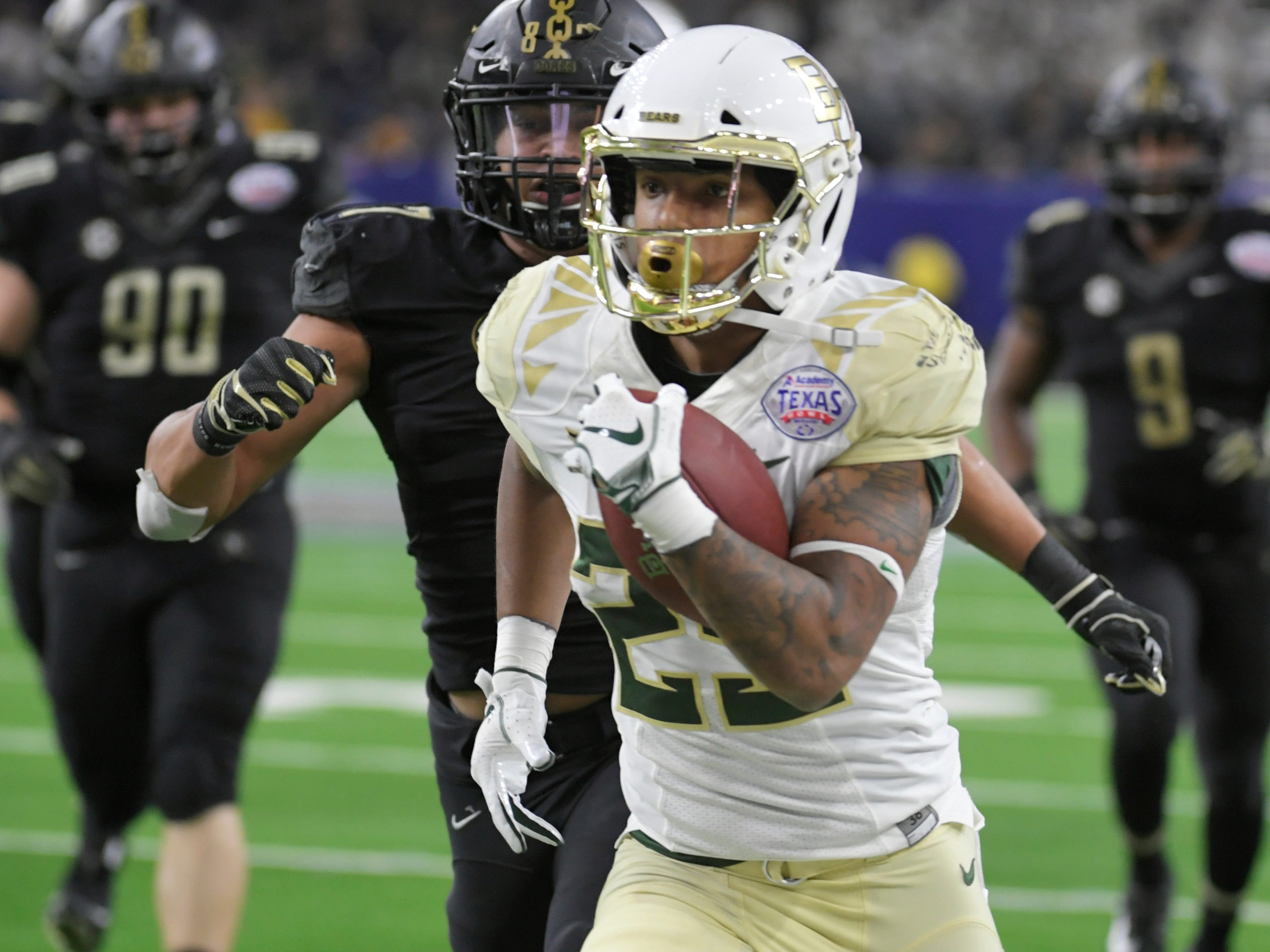 Baylor Bears running back Trestan Ebner (25) runs for a touchdown in the third quarter during the Academy Sports + Outdoors Texas Bowl at NRG Stadium in Houston on Thursday, Dec. 27, 2018.