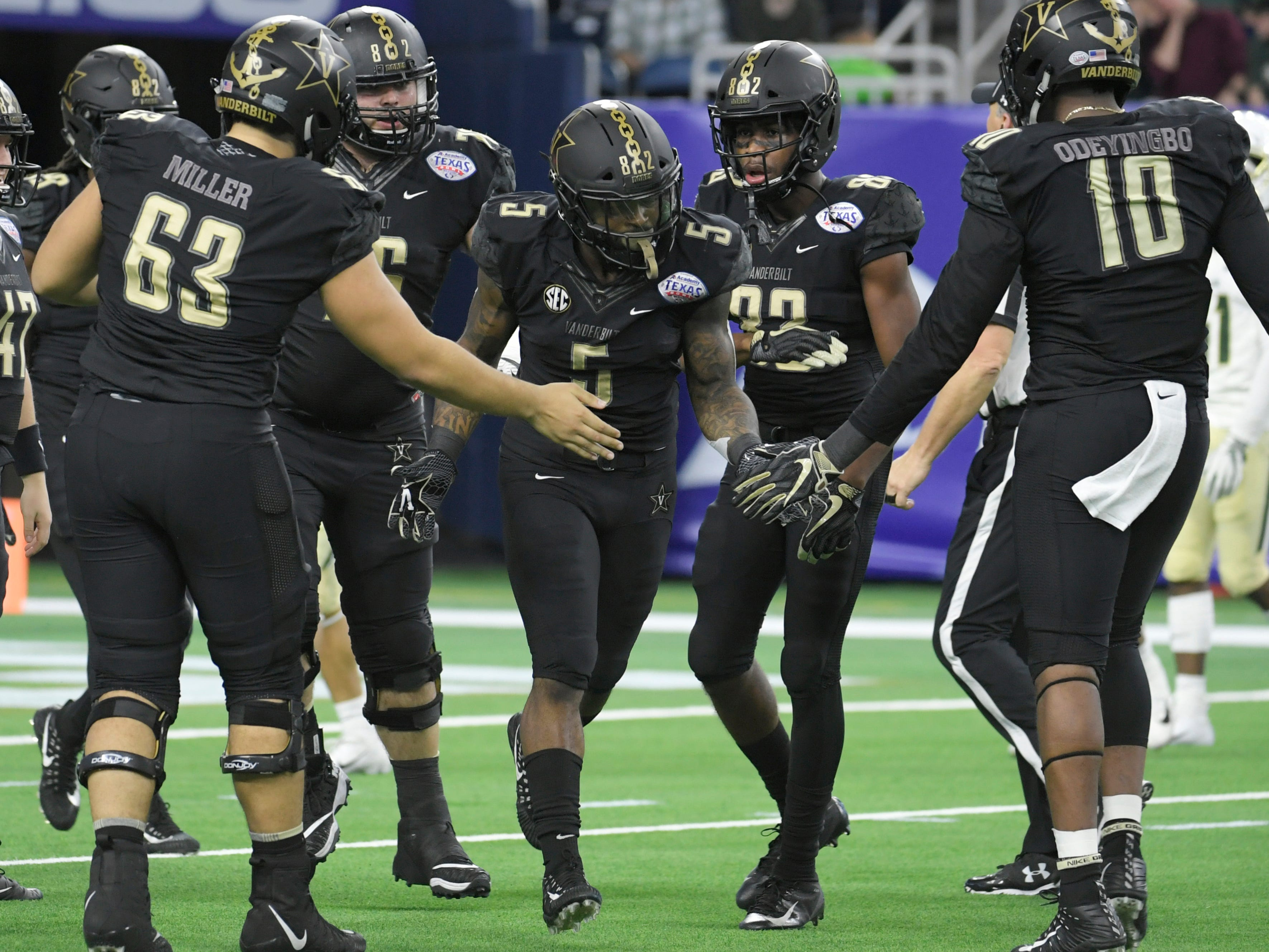 Vanderbilt Commodores running back Ke'Shawn Vaughn (5) is congratulated by his teammates after a 68-yard touchdown in the first quarter of the Academy Sports + Outdoors Texas Bowl at NRG Stadium in Houston on Thursday, Dec. 27, 2018.