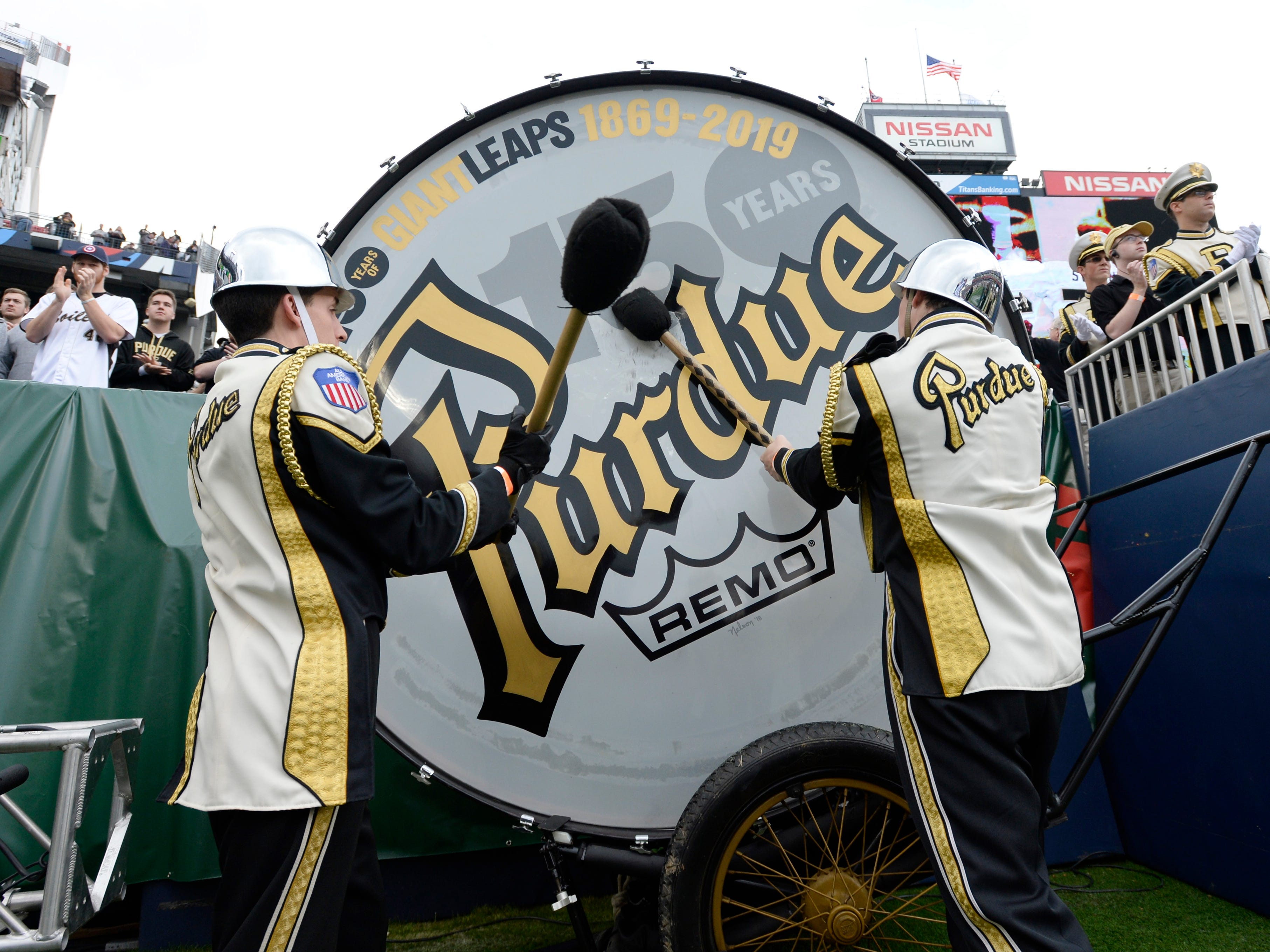 Purdue band members pound the drum before the start of of the Music City Bowl NCAA college football game Friday, Dec. 28, 2018, at Nissan Stadium in Nashville, Tenn.