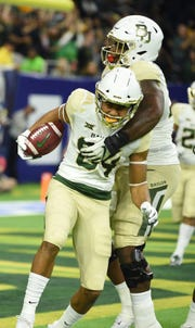 Baylor Bears wide receiver Marques Jones (84) scores in the fourth quarter against Vanderbilt during the Academy Sports + Outdoors Texas Bowl at NRG Stadium in Houston on Thursday, Dec. 27, 2018.