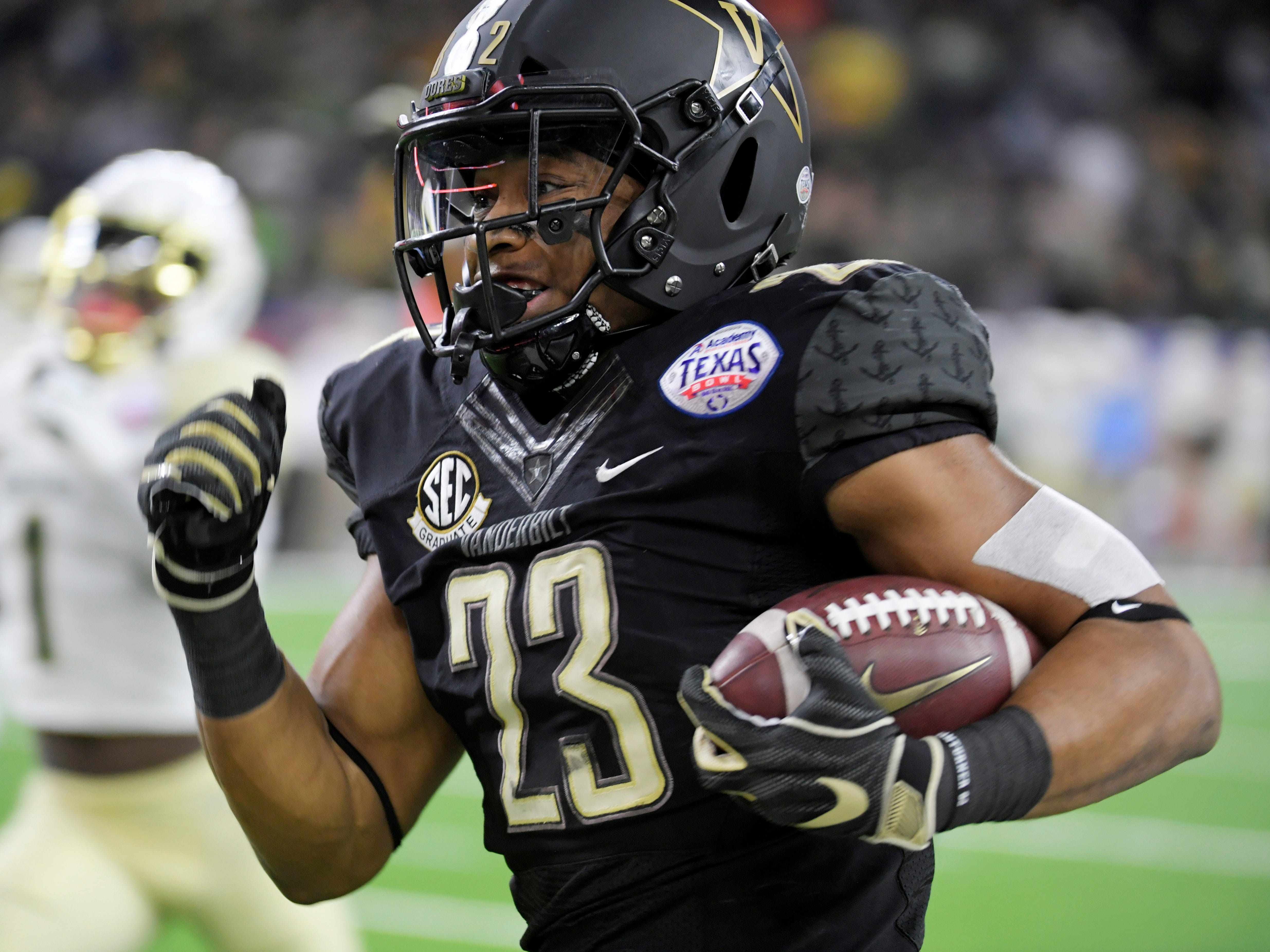 Vanderbilt Commodores running back Khari Blasingame (23) goes in for a touchodown on the team's first possession during the first quarter of the Academy Sports + Outdoors Texas Bowl at NRG Stadium in Houston on Thursday, Dec. 27, 2018.