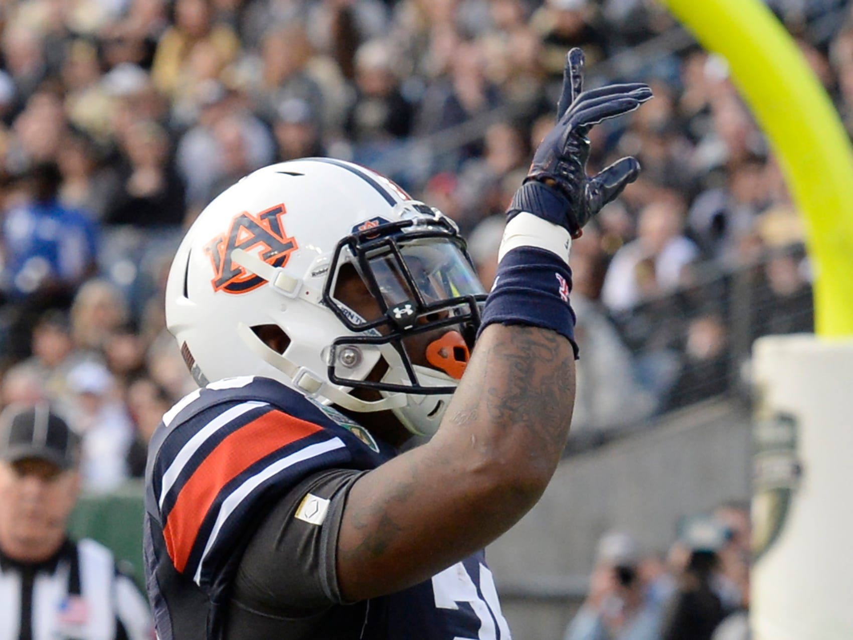Auburn running back JaTarvious Whitlow (28) celebrates his second touchdown of the first quarter of the Music City Bowl NCAA college football game Friday, Dec. 28, 2018, at Nissan Stadium in Nashville, Tenn.