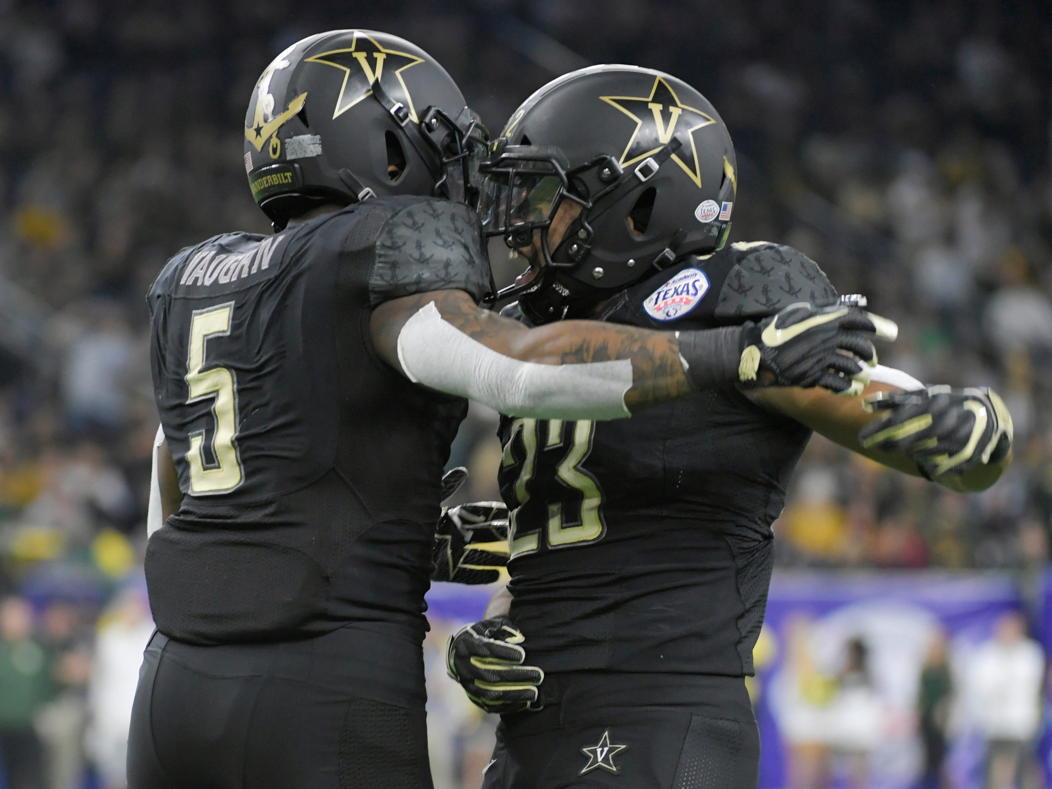 Vanderbilt Commodores running back Ke'Shawn Vaughn (5) celebrates his 68-yard touchdown with Vanderbilt Commodores running back Khari Blasingame (23) in the first quarter of the Academy Sports + Outdoors Texas Bowl at NRG Stadium in Houston on Thursday, Dec. 27, 2018.