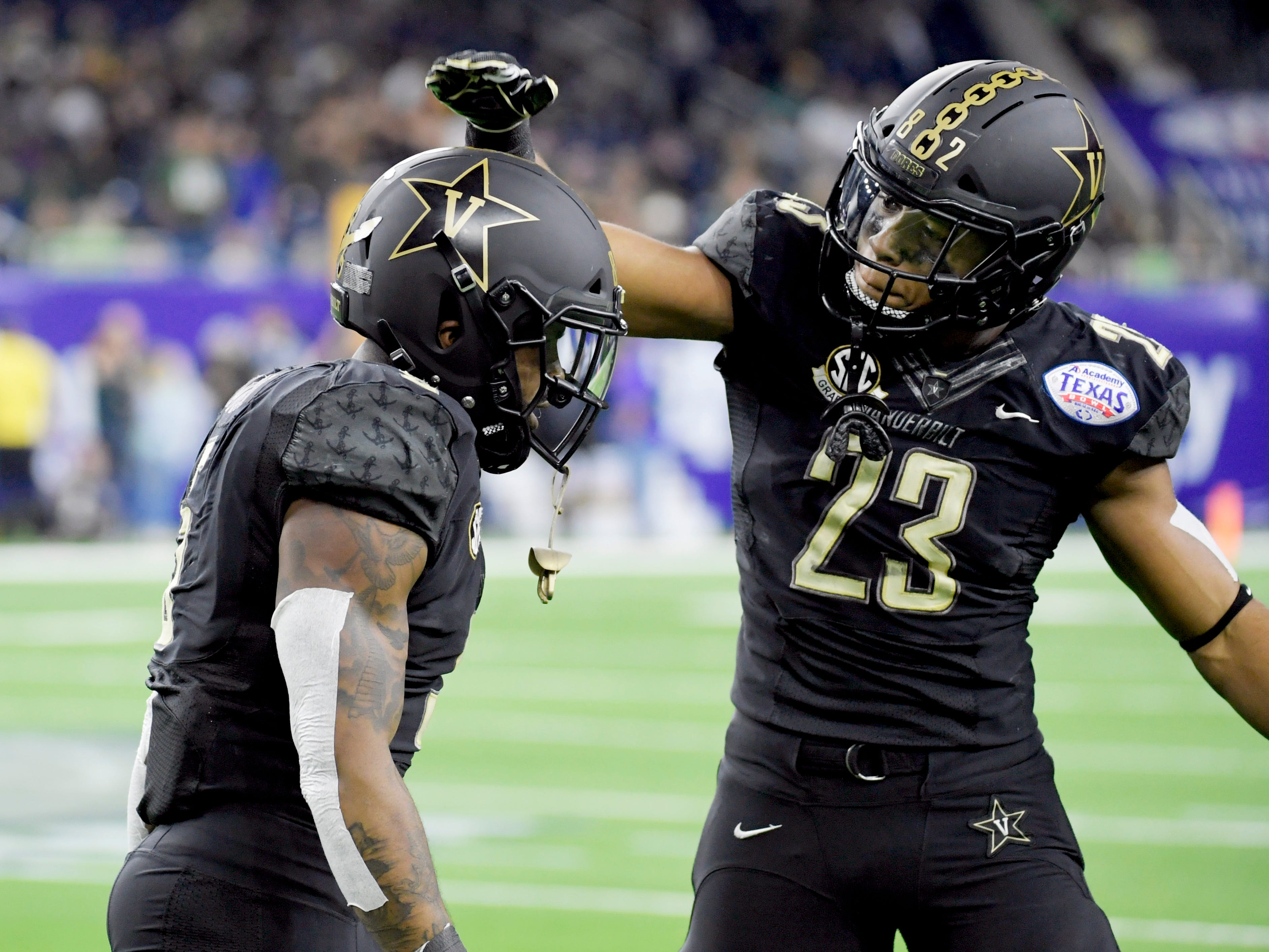 Vanderbilt Commodores running back Khari Blasingame (23) congratulates running back Ke'Shawn Vaughn (5) after his 68-yard touchdown in the first quarter of the Academy Sports + Outdoors Texas Bowl at NRG Stadium in Houston on Thursday, Dec. 27, 2018.