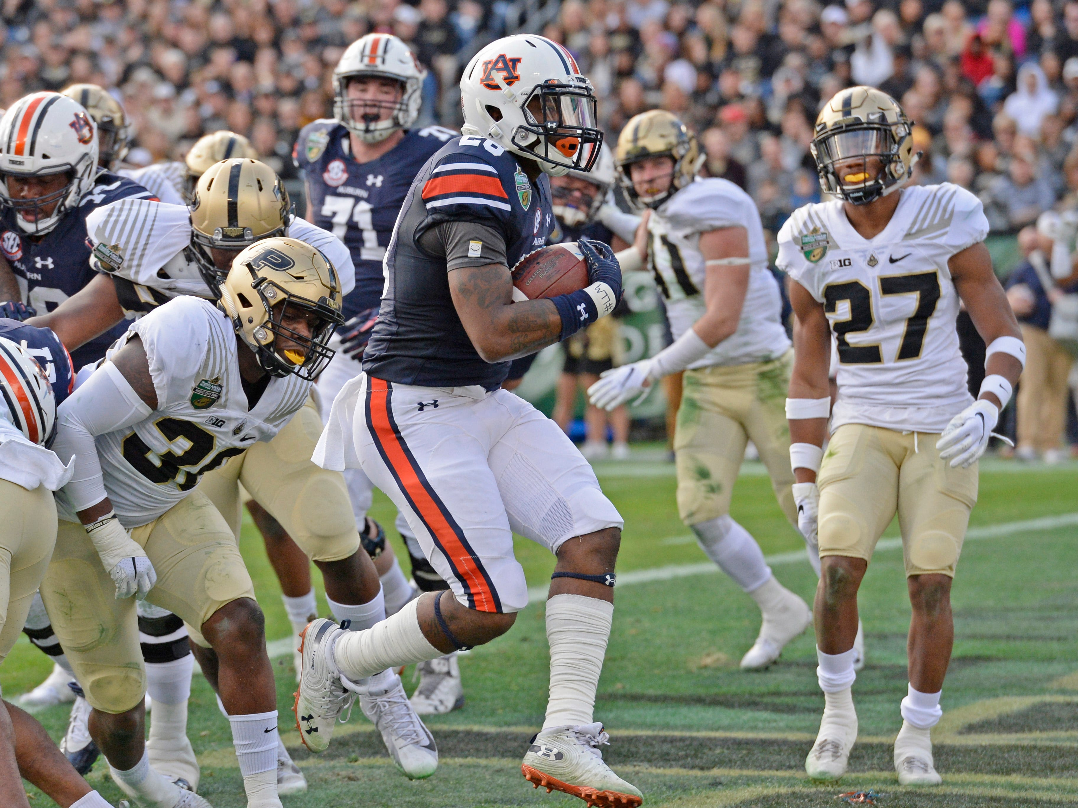 Auburn running back JaTarvious Whitlow (28) runs into the end zone for his second touchdown of the first quarter of the Music City Bowl NCAA college football game Friday, Dec. 28, 2018, at Nissan Stadium in Nashville, Tenn.