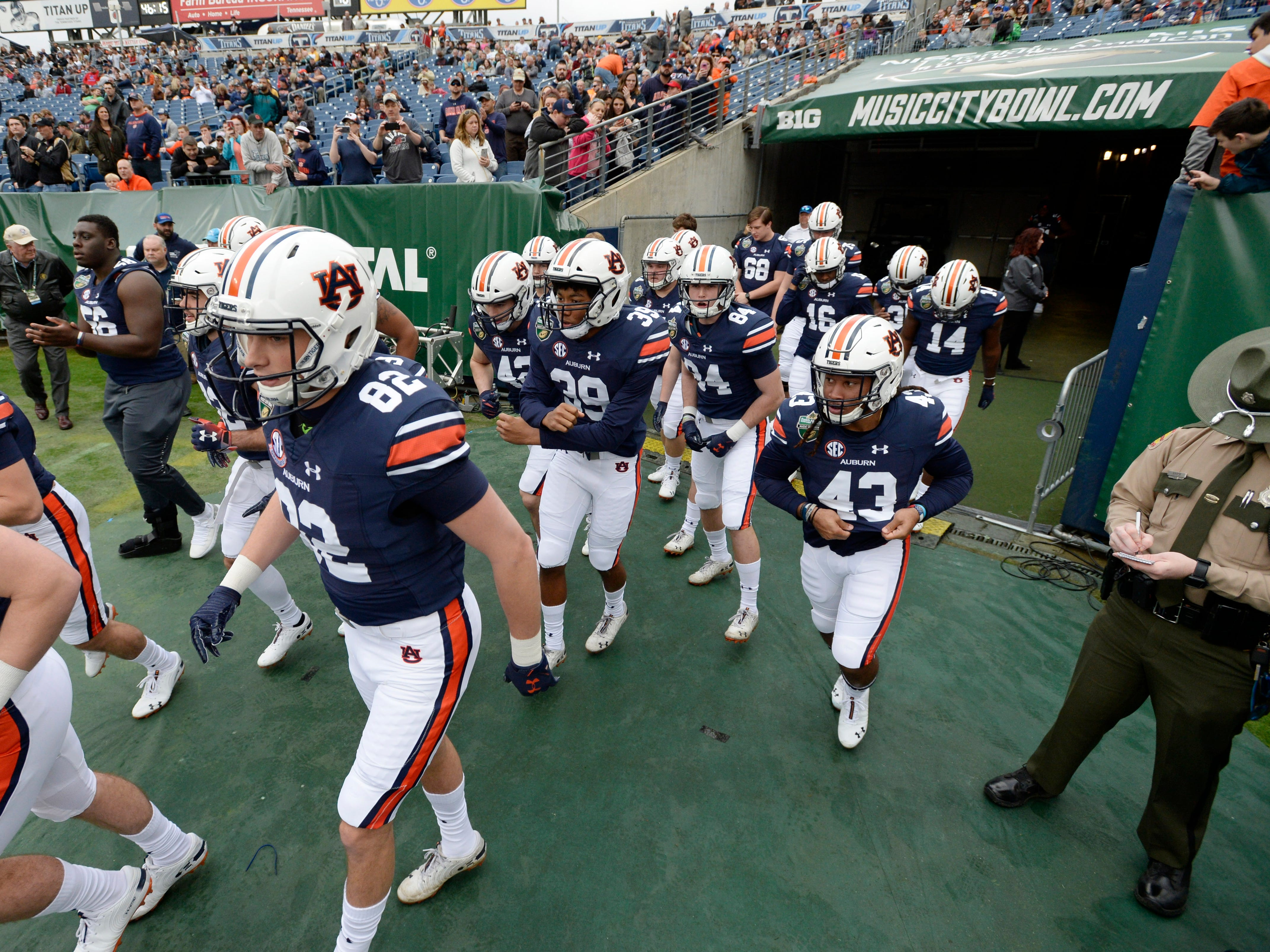 Auburn players take the field before the start of the Music City Bowl NCAA college football game Friday, Dec. 28, 2018, at Nissan Stadium in Nashville, Tenn.