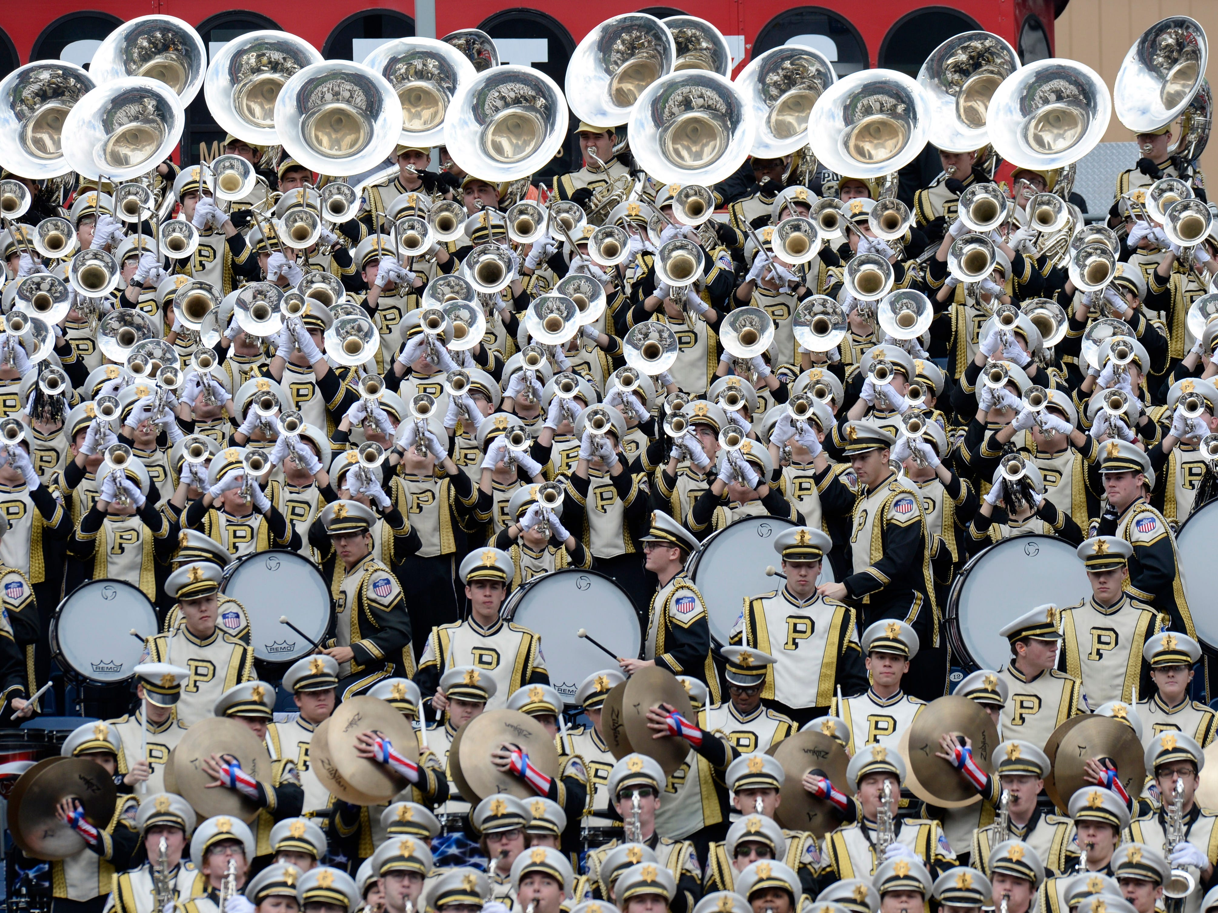 Purdue band members play before the start of the Music City Bowl NCAA college football game Friday, Dec. 28, 2018, at Nissan Stadium in Nashville, Tenn.