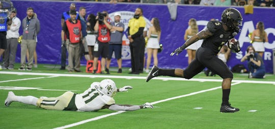 Baylor Bears cornerback Jameson Houston (11) can't stop Vanderbilt Commodores running back Ke'Shawn Vaughn (5) as he scores his second touchdown of the game in the second quarter of the Academy Sports + Outdoors Texas Bowl at NRG Stadium in Houston on Thursday, Dec. 27, 2018.