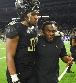 Vanderbilt coach Derek Mason and tight end Jared Pinkney (80) after the team's 45-38 loss to Baylor in the Academy Sports and Outdoors Texas Bowl on Dec. 27.