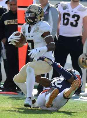 Auburn defensive back Jamel Dean (12) stops Purdue wide receiver Isaac Zico (7) in the first half of the Music City Bowl NCAA college football game Friday, Dec. 28, 2018, at Nissan Stadium in Nashville, Tenn.