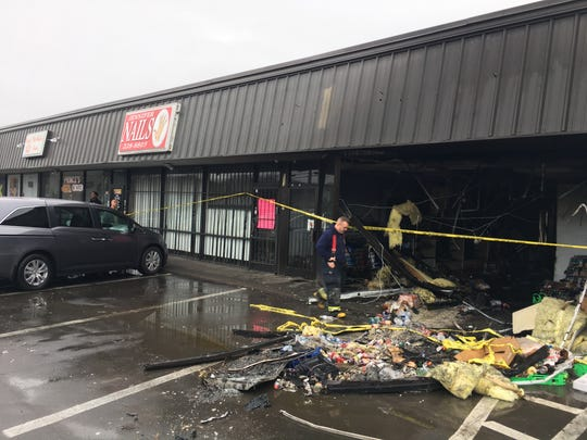 A vehicle crashed Friday, Dec. 28, 2018, into a strip mall on Ewing Drive, damaging several businesses, including Prince's Hot Chicken Shack.
