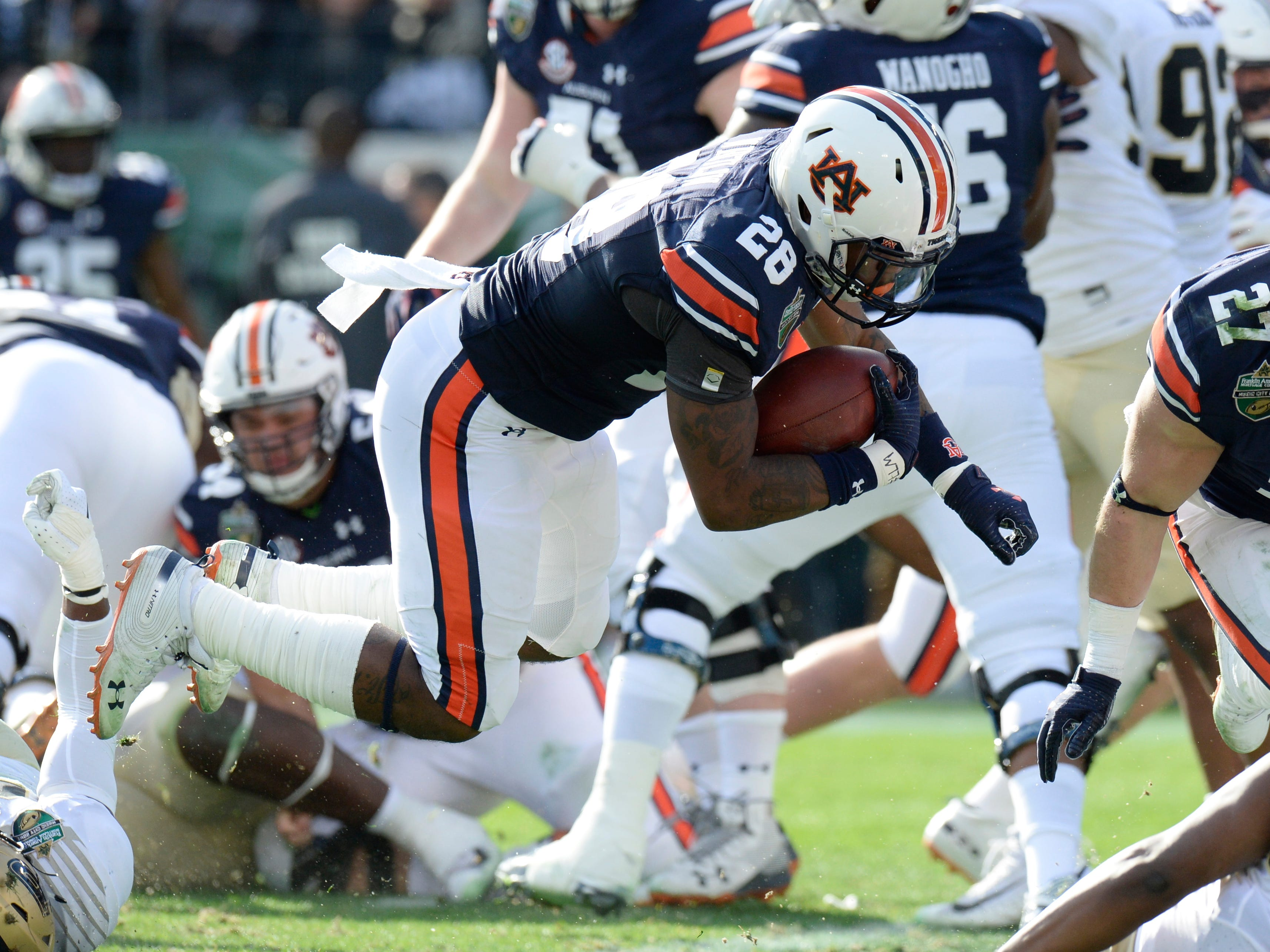 Auburn running back JaTarvious Whitlow (28) goes in for his third touchdown of the first quarter of the Music City Bowl NCAA college football game Friday, Dec. 28, 2018, at Nissan Stadium in Nashville, Tenn.