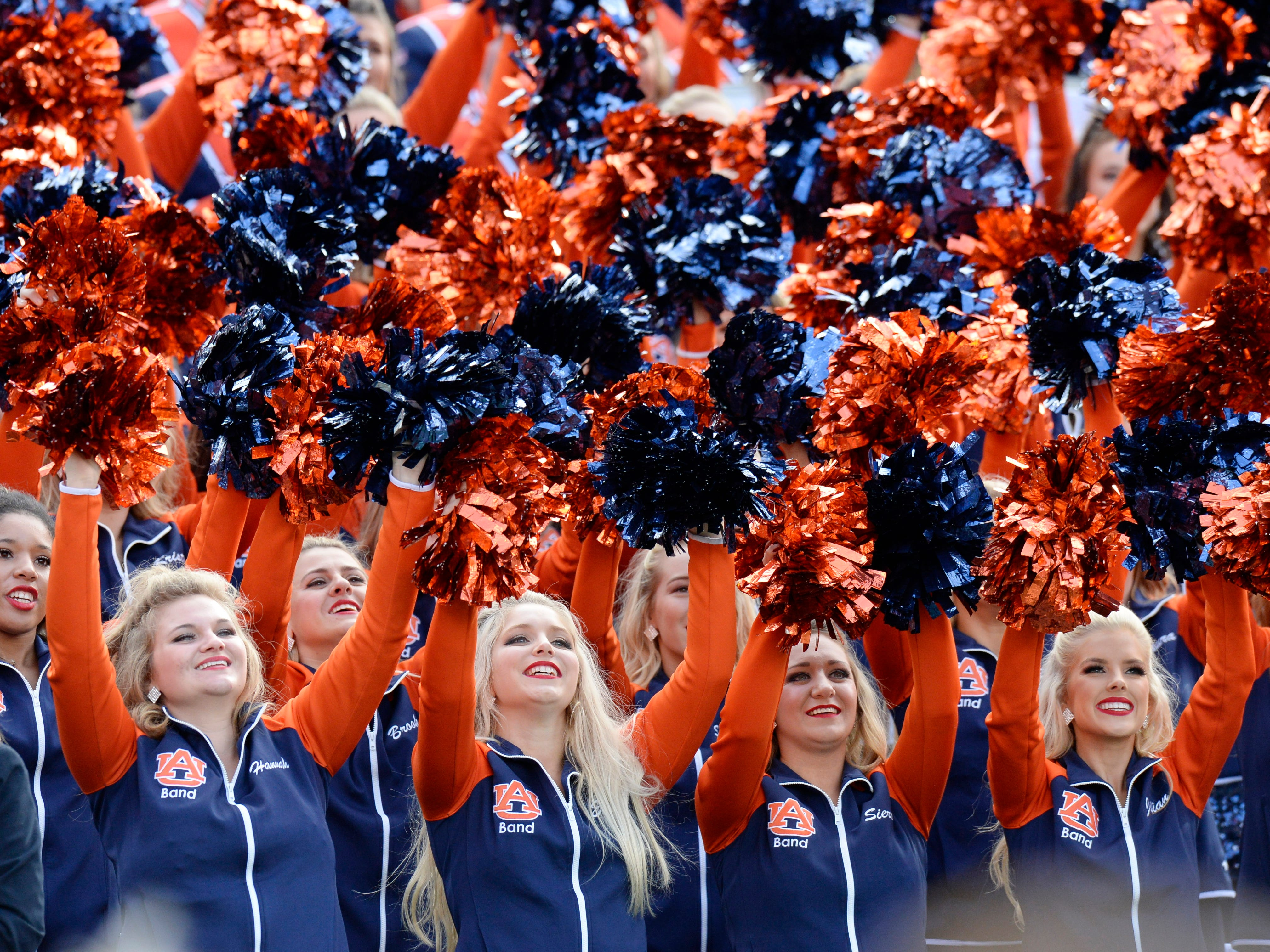 Auburn's cheerleaders lead their fans at the Music City Bowl NCAA college football game Friday, Dec. 28, 2018, at Nissan Stadium in Nashville, Tenn.