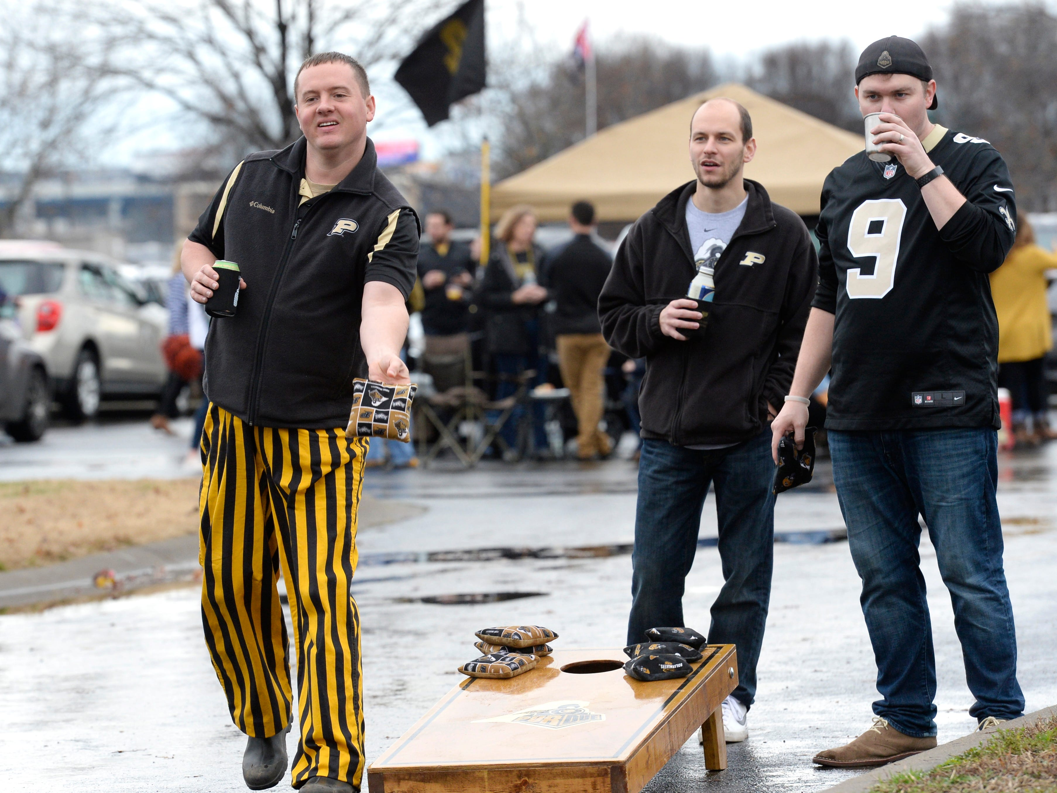 Purdue fans play corn hole before the start of the Music City Bowl NCAA college football game Friday, Dec. 28, 2018, at Nissan Stadium in Nashville, Tenn.