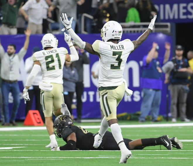 Baylor players start to celebrate after an incomplete pass by Vanderbilt Commodores quarterback Kyle Shurmur (14) on fourth down late in the fourth quarter in the Academy Sports + Outdoors Texas Bowl at NRG Stadium in Houston on Thursday, Dec. 27, 2018.