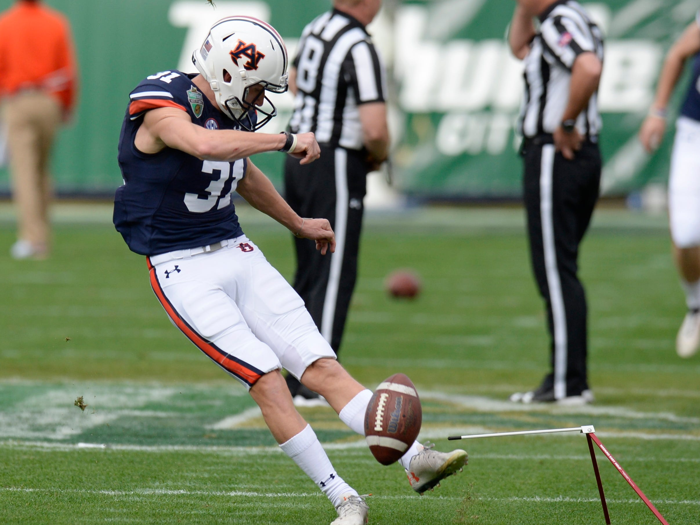 Auburn place kicker Sage Ledbetter (31) warms up before the start of the Music City Bowl NCAA college football game Friday, Dec. 28, 2018, at Nissan Stadium in Nashville, Tenn.