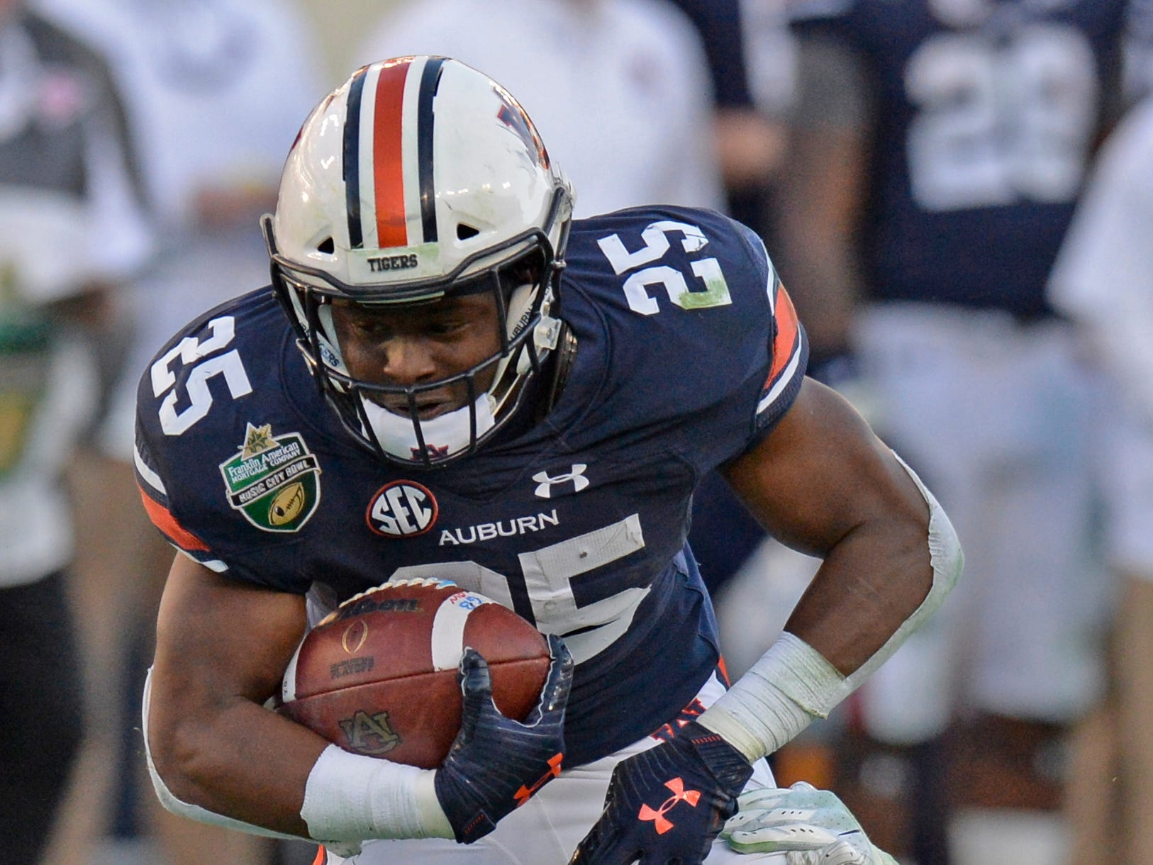 Auburn running back Shaun Shivers (25) gains yards in the fourth quarter of the Music City Bowl NCAA college football game Friday, Dec. 28, 2018, at Nissan Stadium in Nashville, Tenn.