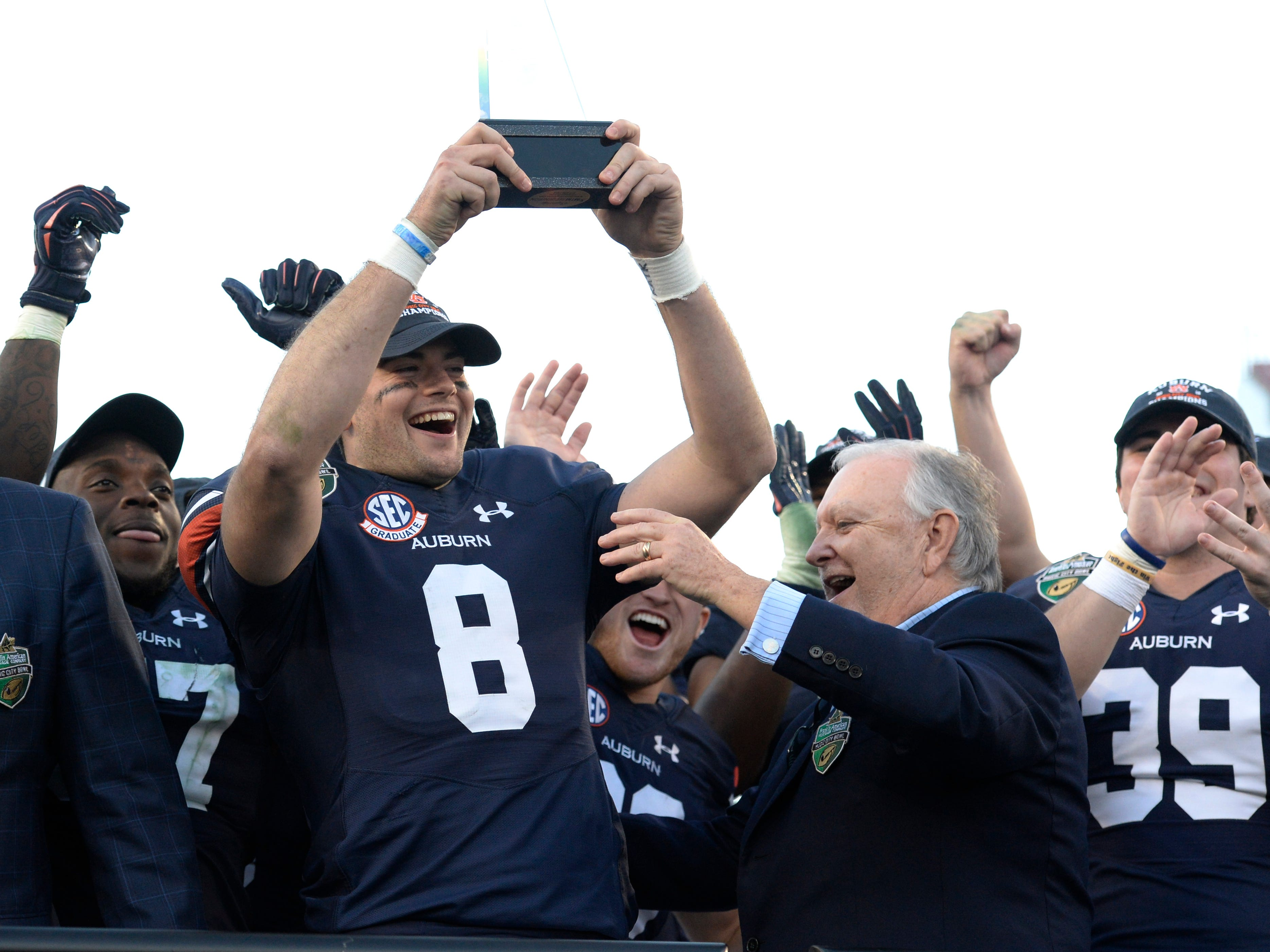 Auburn quarterback Jarrett Stidham (8) holds the MVP trophy after the team beat Purdue 63-14 in the Music City Bowl NCAA college football game Friday, Dec. 28, 2018, at Nissan Stadium in Nashville, Tenn.