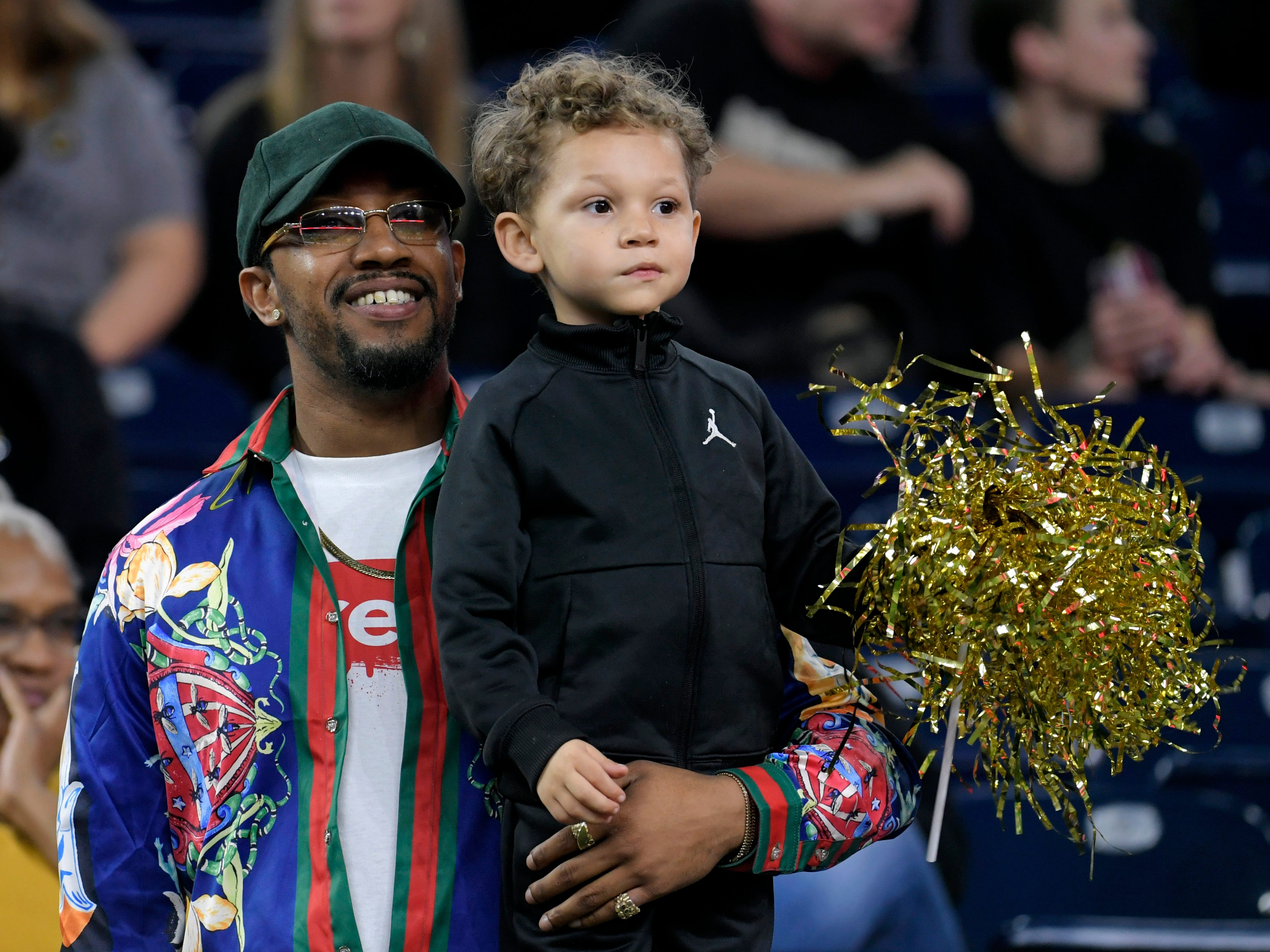 Larry Dotson holds his son, Layton, 4, as they watch Vanderbilt player Ladarius Wiley, Larry's brother, warm up before the Academy Sports + Outdoors Texas Bowl at NRG Stadium in Houston on Thursday, Dec. 27, 2018.