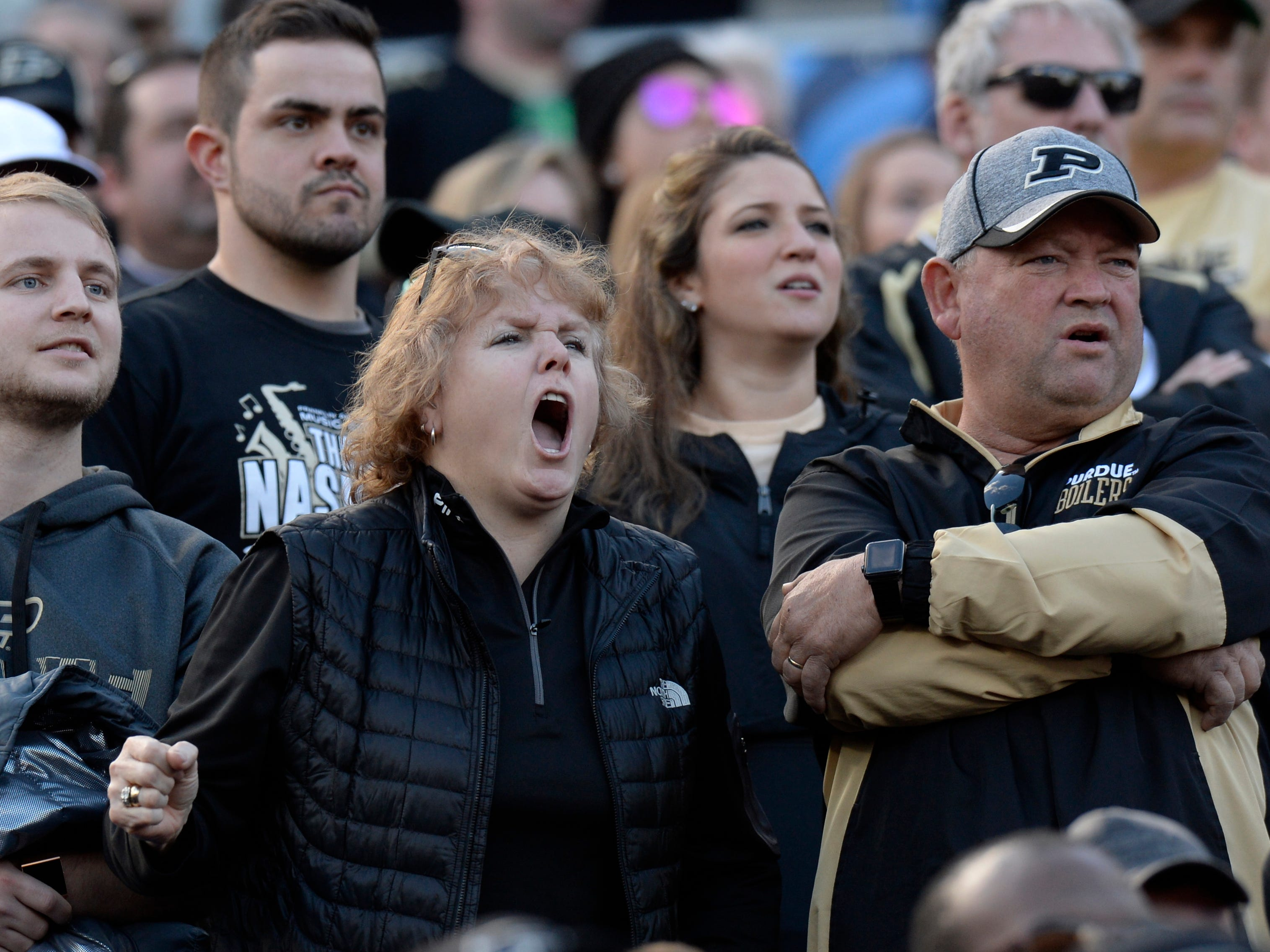 Purdue fans yell during the second quarter of the Music City Bowl NCAA college football game Friday, Dec. 28, 2018, at Nissan Stadium in Nashville, Tenn.