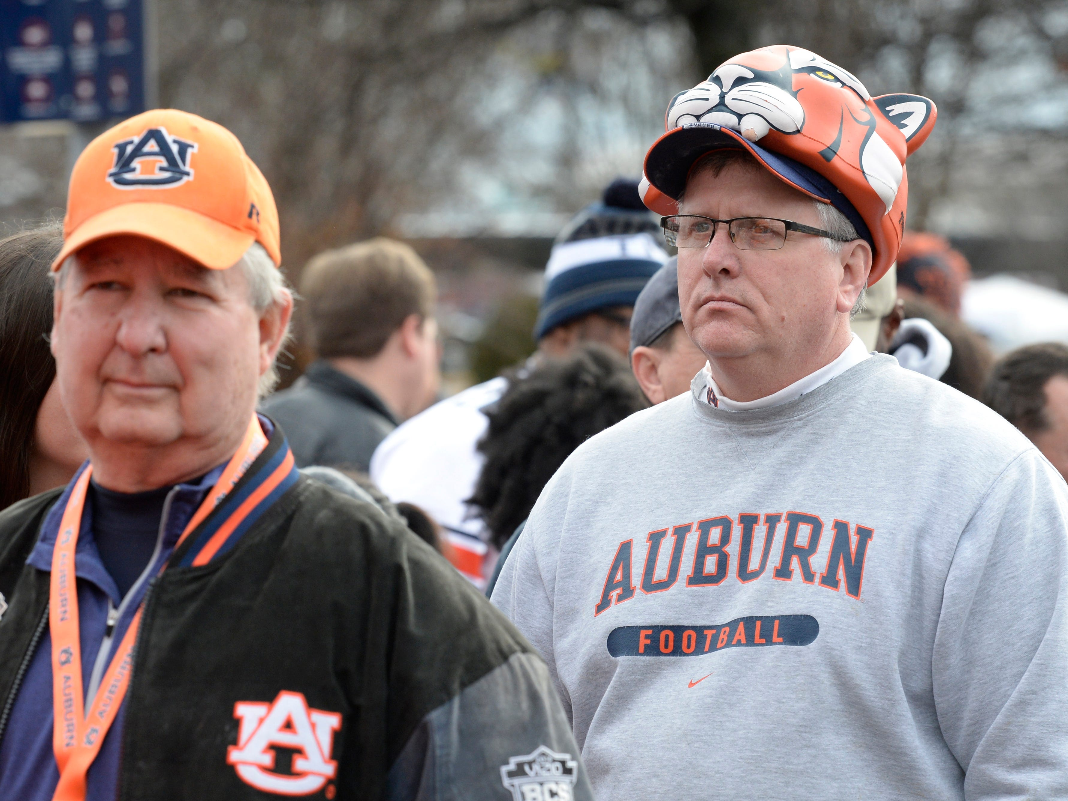 Auburn fans -- complete with Tigers gear -- wait in line to get in for the start of the Music City Bowl NCAA college football game Friday, Dec. 28, 2018, at Nissan Stadium in Nashville, Tenn.