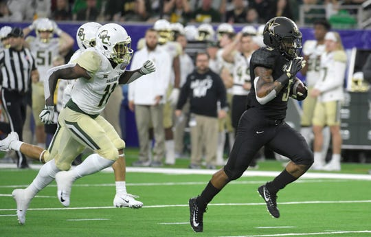 Vanderbilt Commodores running back Ke'Shawn Vaughn (5) goes in for his second touchdown of the game in the second quarter of  the Academy Sports + Outdoors Texas Bowl at NRG Stadium in Houston on Thursday, Dec. 27, 2018.