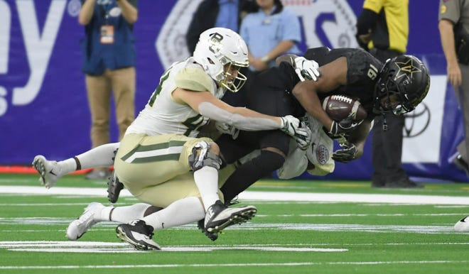 Baylor Bears linebacker Clay Johnston (44) stops Vanderbilt Commodores wide receiver Kalija Lipscomb (16) during the third quarter of the Academy Sports + Outdoors Texas Bowl at NRG Stadium in Houston on Thursday, Dec. 27, 2018.