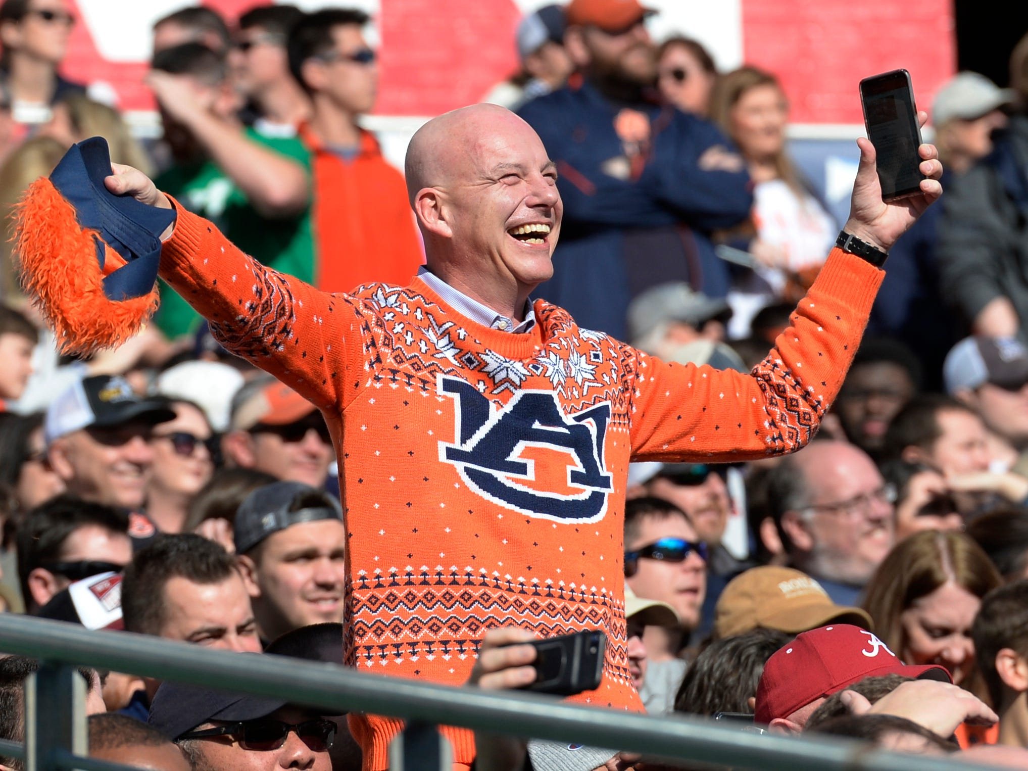 An Auburn fan likes what he sees in the first half of the Music City Bowl NCAA college football game Friday, Dec. 28, 2018, at Nissan Stadium in Nashville, Tenn.