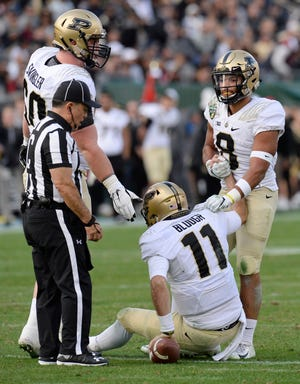 Purdue offensive lineman Eric Swingler (60) and running back Markell Jones (8) help up quarterback David Blough (11) after a sack in the second quarter of the Music City Bowl NCAA college football game Friday, Dec. 28, 2018, at Nissan Stadium in Nashville, Tenn.
