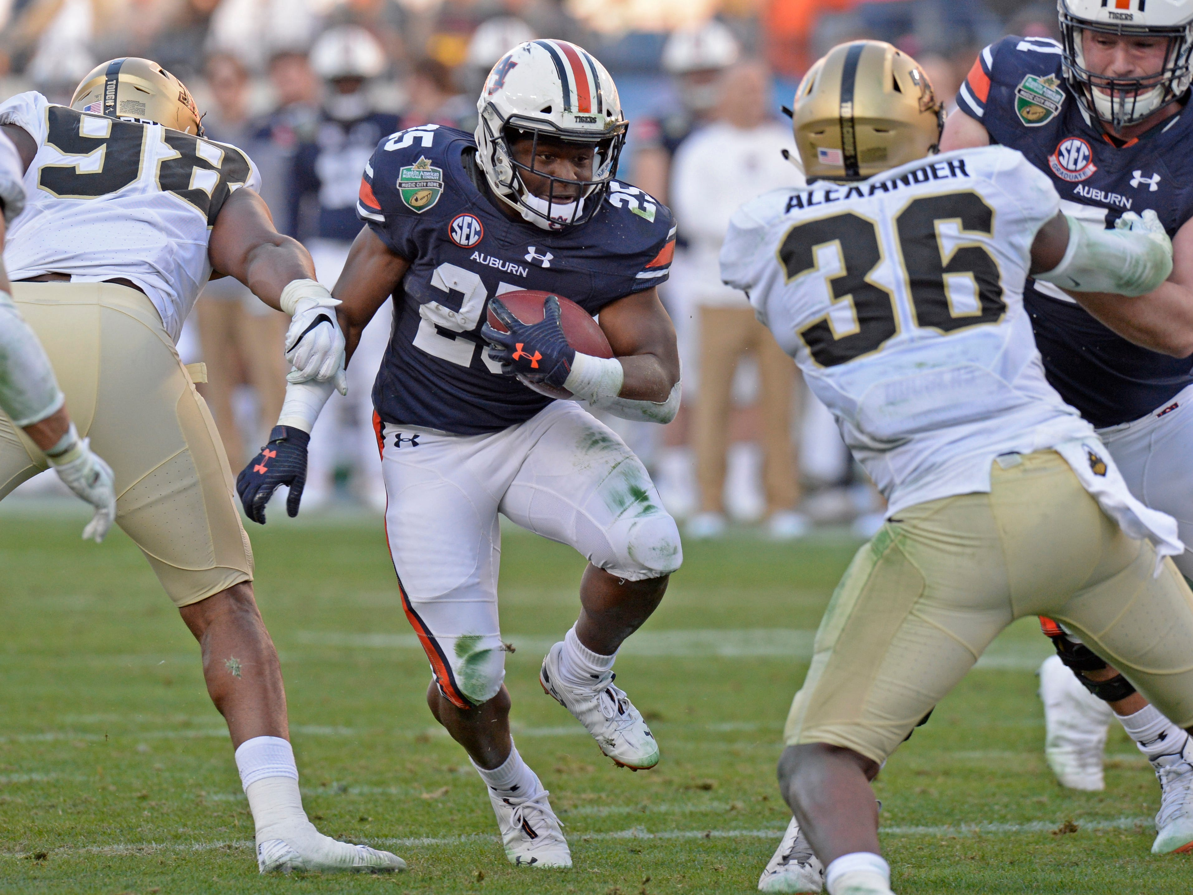 Auburn running back Shaun Shivers (25) gains yards in the third quarter of the Music City Bowl NCAA college football game Friday, Dec. 28, 2018, at Nissan Stadium in Nashville, Tenn.