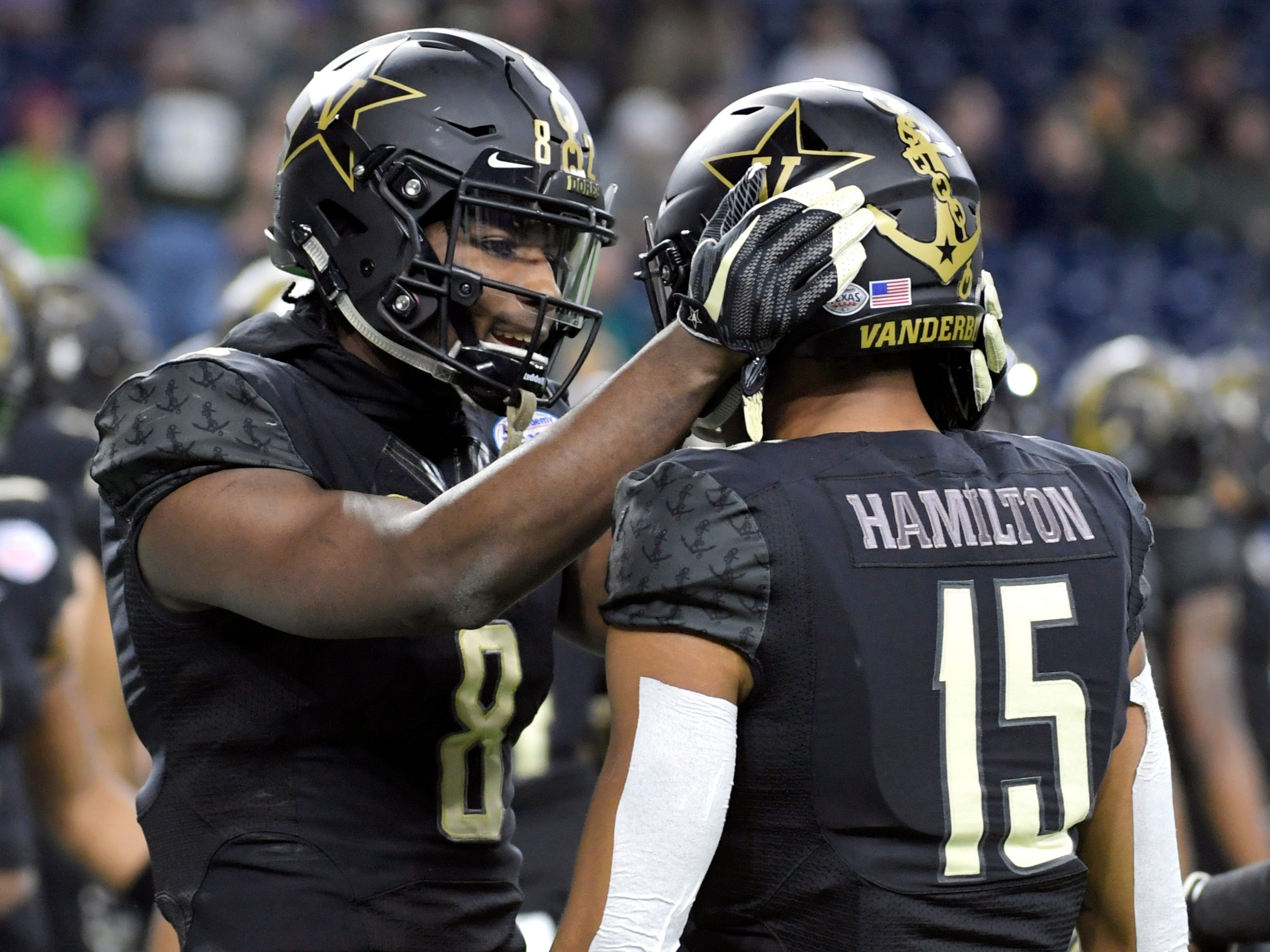 Vanderbilt Commodores cornerback Joejuan Williams (8) and Vanderbilt Commodores defensive back Elijah Hamilton (15) warm up before the Academy Sports + Outdoors Texas Bowl at NRG Stadium in Houston on Thursday, Dec. 27, 2018.
