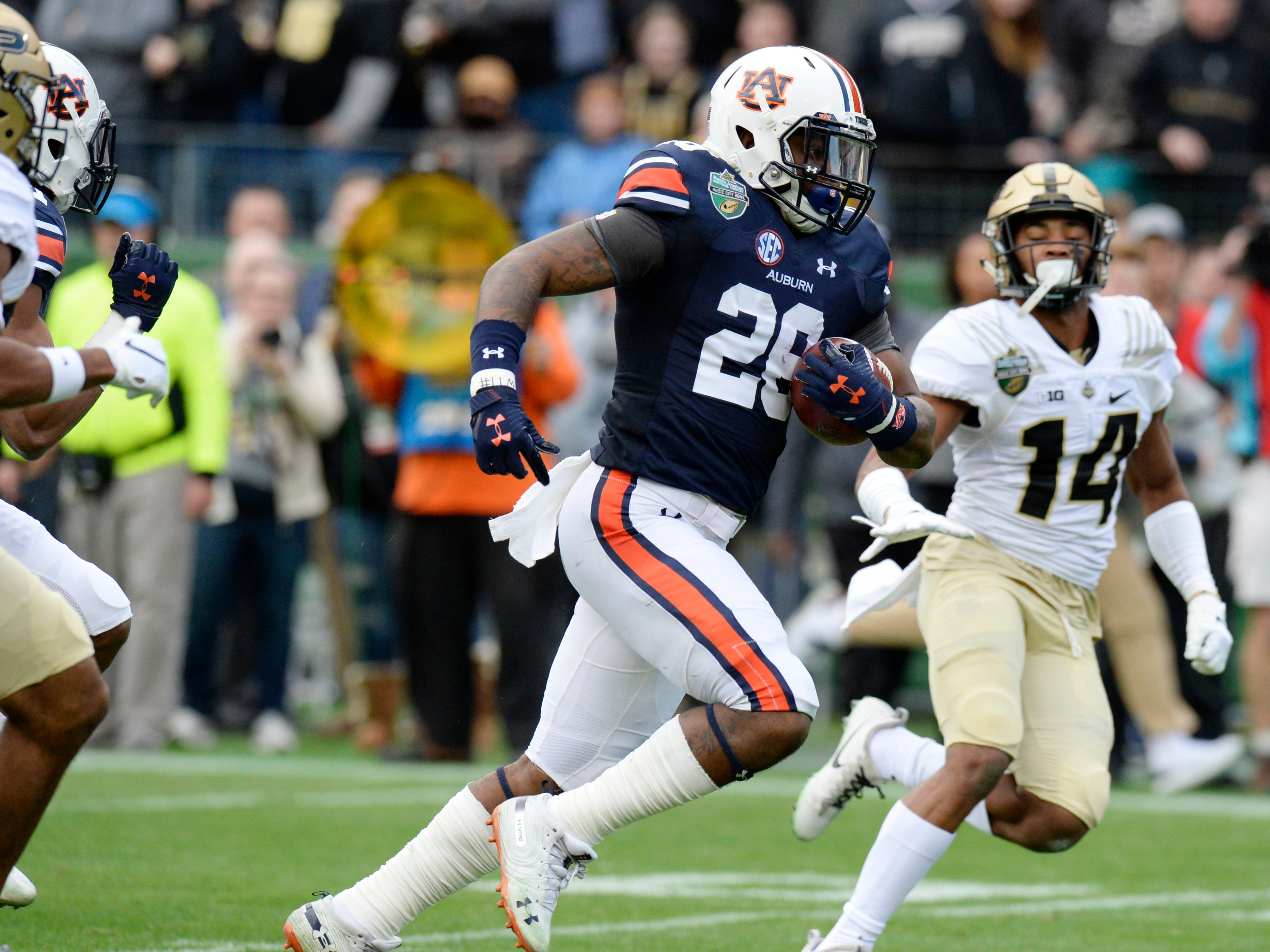 Auburn running back JaTarvious Whitlow (28) takes off on his 66-yard touchdown in the first quarter of the Music City Bowl NCAA college football game Friday, Dec. 28, 2018, at Nissan Stadium in Nashville, Tenn.