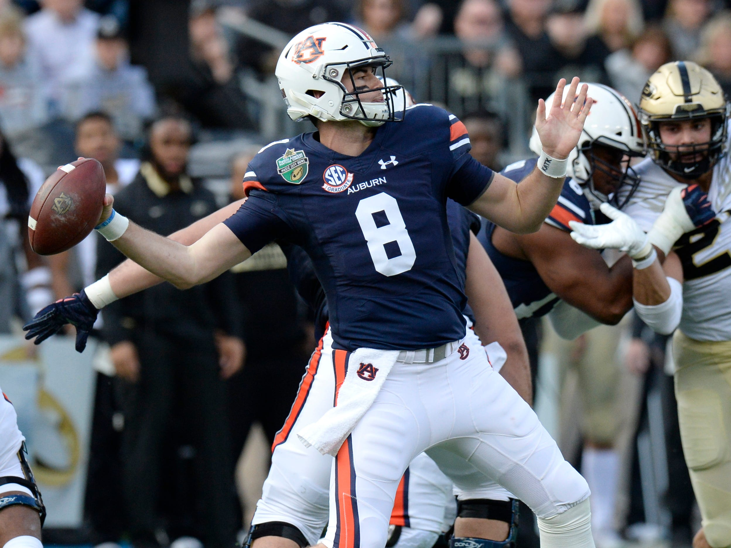 Auburn quarterback Jarrett Stidham (8) drops back to pass in the first quarter of the Music City Bowl NCAA college football game Friday, Dec. 28, 2018, at Nissan Stadium in Nashville, Tenn.