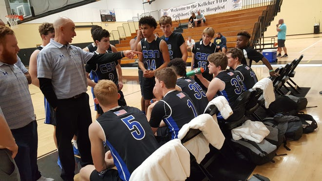 Community School of Naples boys basketball coach Greg Donahue addresses his team before tipoff in the Kelleher Firm Gulfshore Holiday Hoopfest quarterfinals on Friday.