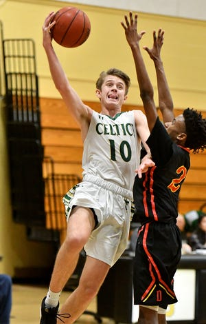 Trinity Catholic's Gunner Munn (10), who transferred from Gainesville-Buchholz, is one of two transfers trying to fit in with returning starters for the Celtics in the Kelleher Firm Gulfshore Holiday Hoopfest.