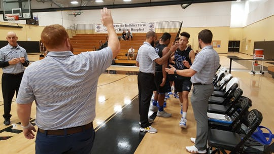 The Community School of Naples boys basketball team is introduced before the quarterfinals of the Kelleher Firm Gulfshore Holiday Hoopfest on Friday.