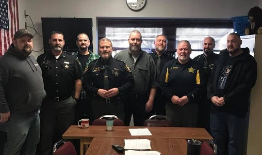 A group who participated in the Licking County Sheriff's Office No Shave November pose for a photo. About 150 employees raised over $5,000 last month for Sgt. Marcus Ramsey (center), who is battling cancer.