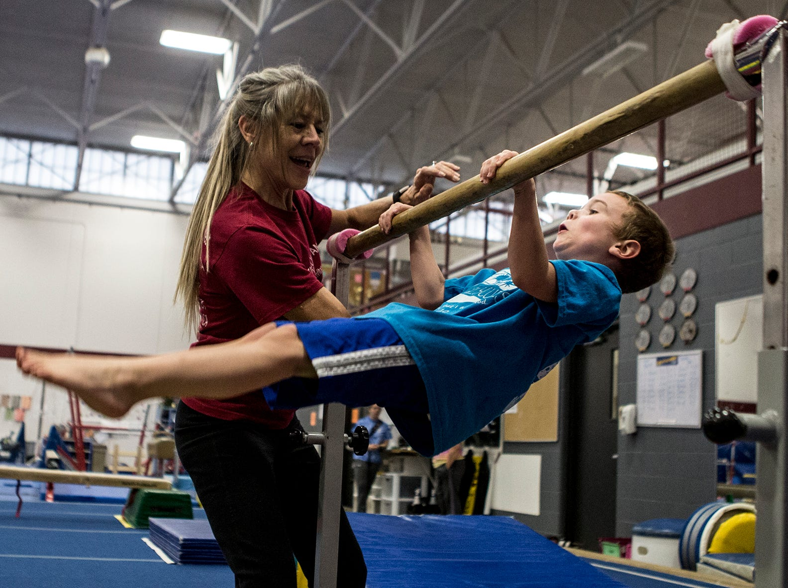 Jeanne Reid helps Micaiah Swick work on flipping around the bar during a preschool open gymnastics class at the Licking County YMCA. The YMCA will be holding a second preschool open gym Friday January 4th in the Mitchell Center. Prices are $15 for members and $25 for nonmembers, ages 3-6.