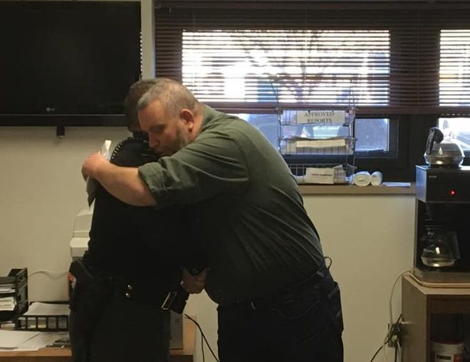 Licking County Sheriff Randy Thorp (left) and Sgt. Marcus Ramsey (right) embrace during a meeting at the Licking County Sheriff's Office in November. The agency raised over $5,000 by participating in No Shave November and proceeds will benefit Ramsey, who is battling cancer.