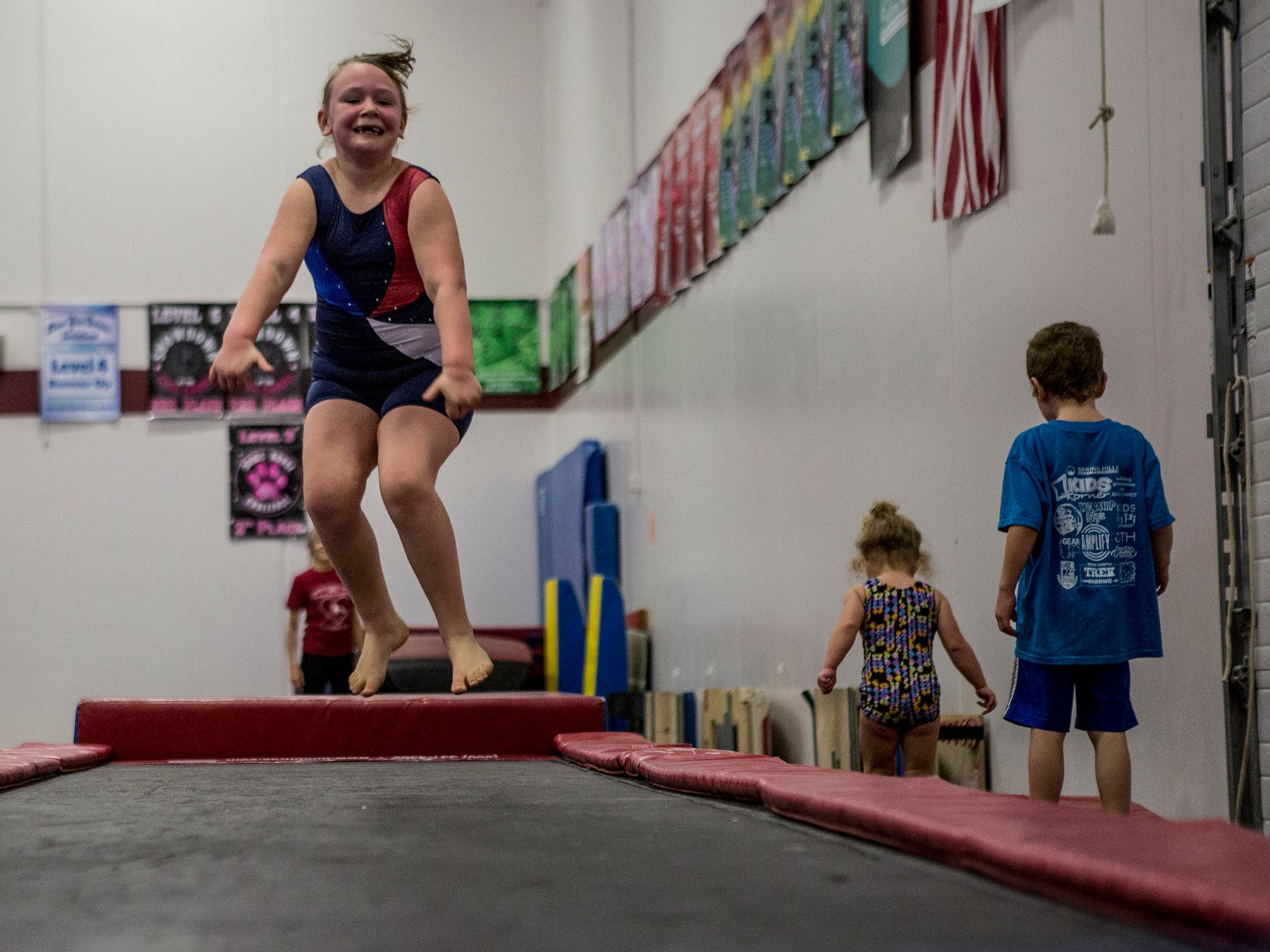 Alyssa Swick, 6, jumps across a track during an open gym for kids ages 3-6 at the Licking County YMCA. The YMCA will be holding a second preschool open gym Friday January 4th in the Mitchell Center. Prices are $15 for members and $25 for nonmembers, ages 3-6.