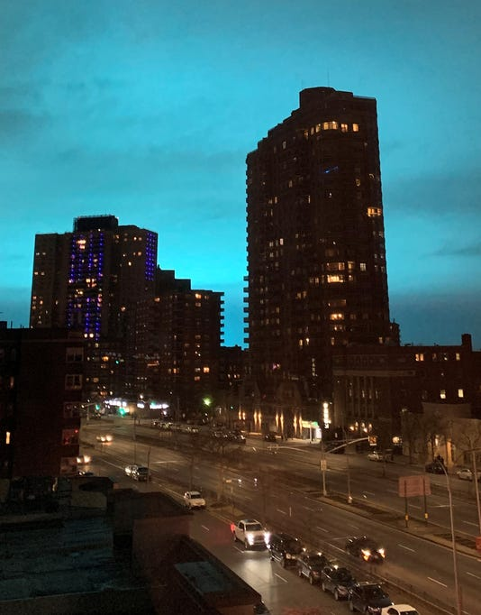 night sky in astoria queens turns bright blue after con ed explosion