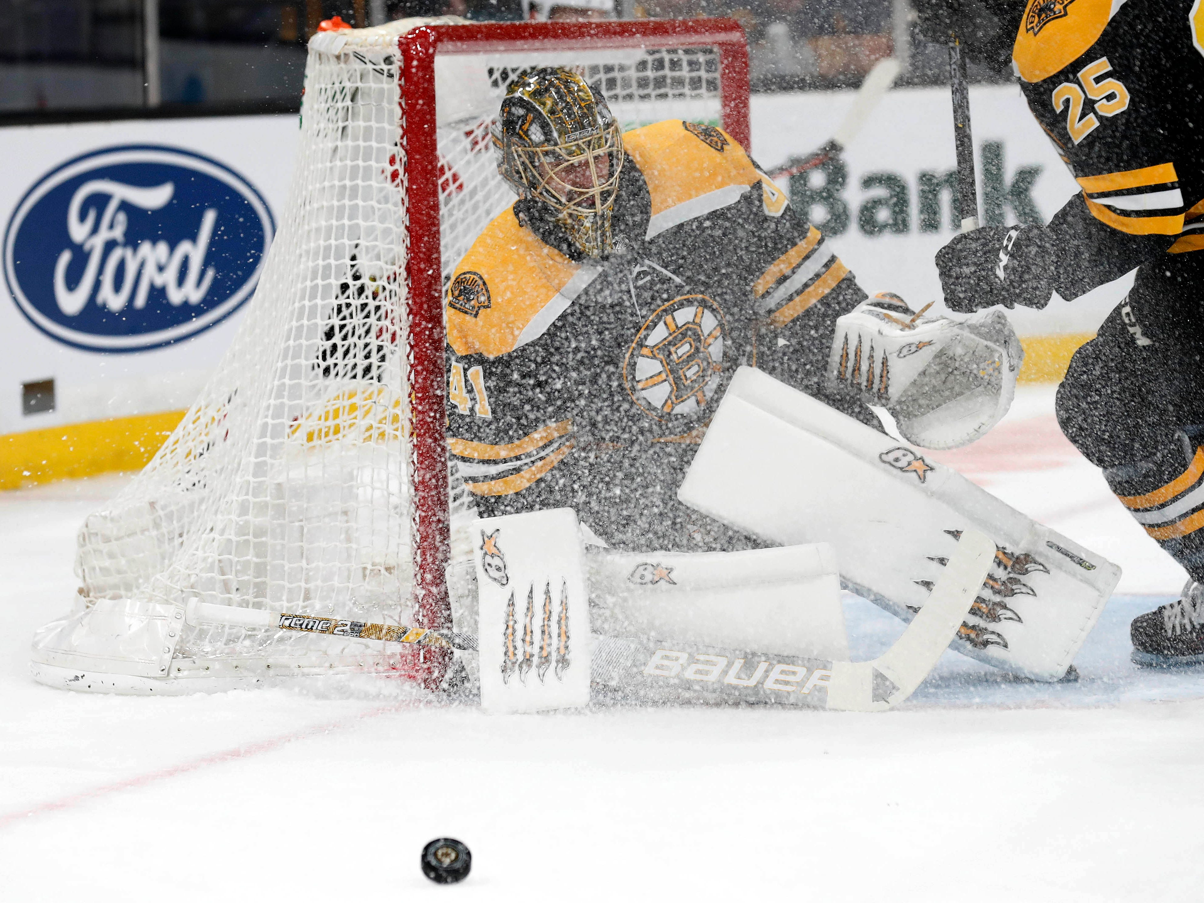 Dec 27, 2018; Boston, MA, USA; Boston Bruins goaltender Jaroslav Halak (41) keeps an eye on the rebound after being sprayed with ice during the first period against the New Jersey Devils at TD Garden.