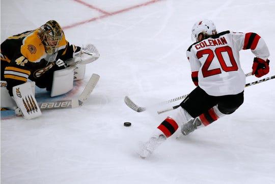 New Jersey Devils center Blake Coleman (20) scores a breakaway goal against Boston Bruins goaltender Jaroslav Halak during the third period of an NHL hockey game Thursday, Dec. 27, 2018, in Boston.