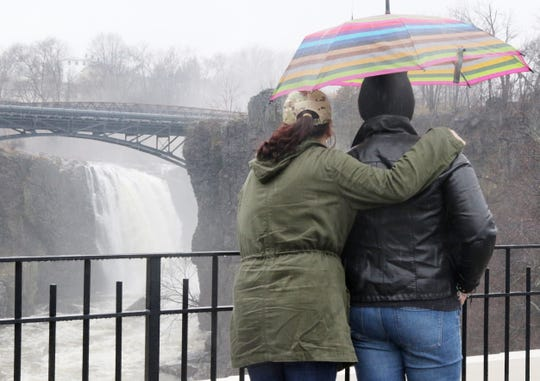 Rain on Dec. 28 pushed New Jersey into the record books. The heavy rain and fog didn't prevent long time North Bergen resident Jessie Vargas from visiting The Great Falls in Paterson for the first time that day. She is with her friend Marisol Sanchez who came to visit from Puerto Rico.