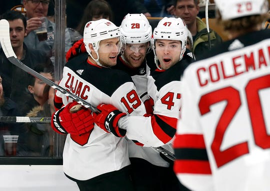 Dec 27, 2018; Boston, MA, USA; New Jersey Devils defenseman Damon Severson (28) celebrates with Devils center Travis Zajac (19) and Devils center John Quenneville (47) after scoring a goal against the Boston Bruins during the first period at TD Garden.