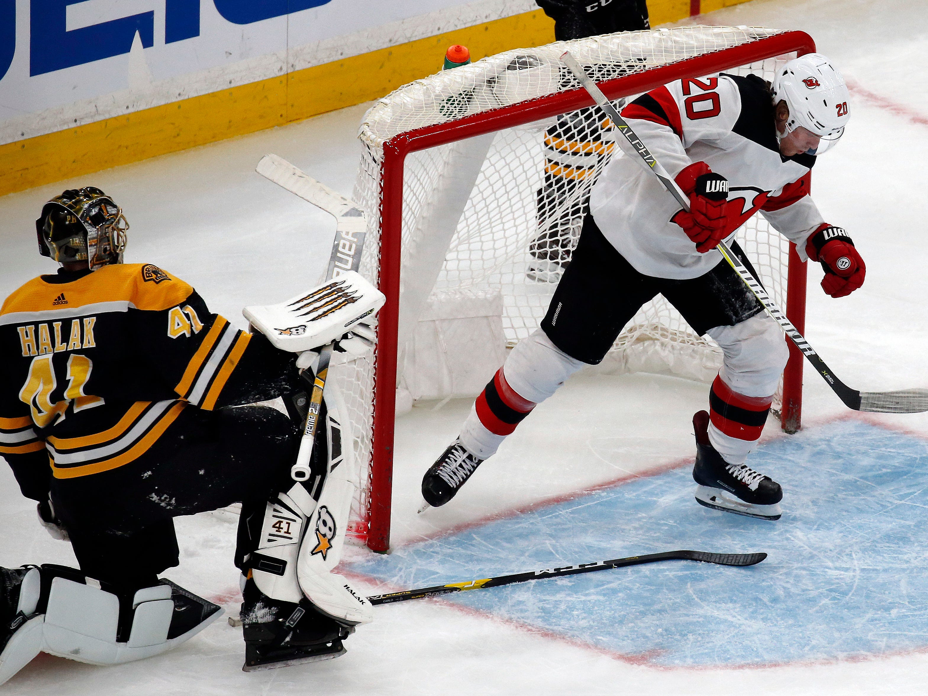 New Jersey Devils center Blake Coleman (20) comes out of the net after scoring a breakaway goal against Boston Bruins goaltender Jaroslav Halak (41) during the third period of an NHL hockey game Thursday, Dec. 27, 2018, in Boston.