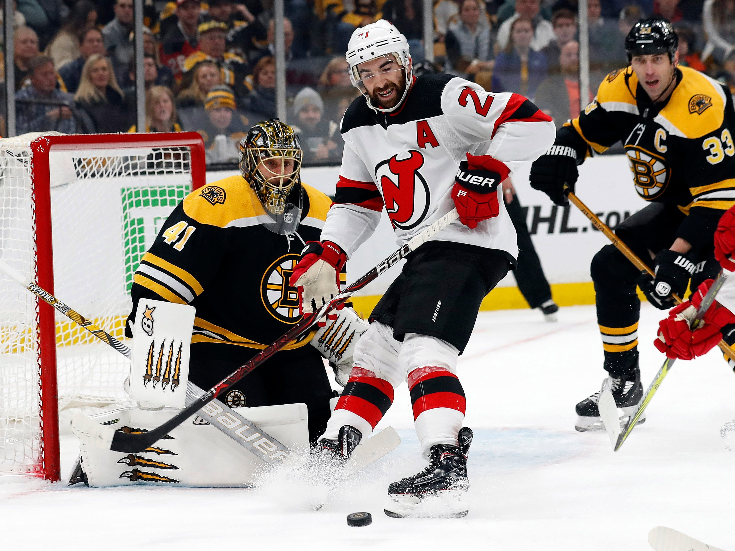 Dec 27, 2018; Boston, MA, USA; New Jersey Devils right wing Kyle Palmieri (21) looks for a loose puck in front of Boston Bruins goaltender Jaroslav Halak (41) during the first period at TD Garden.