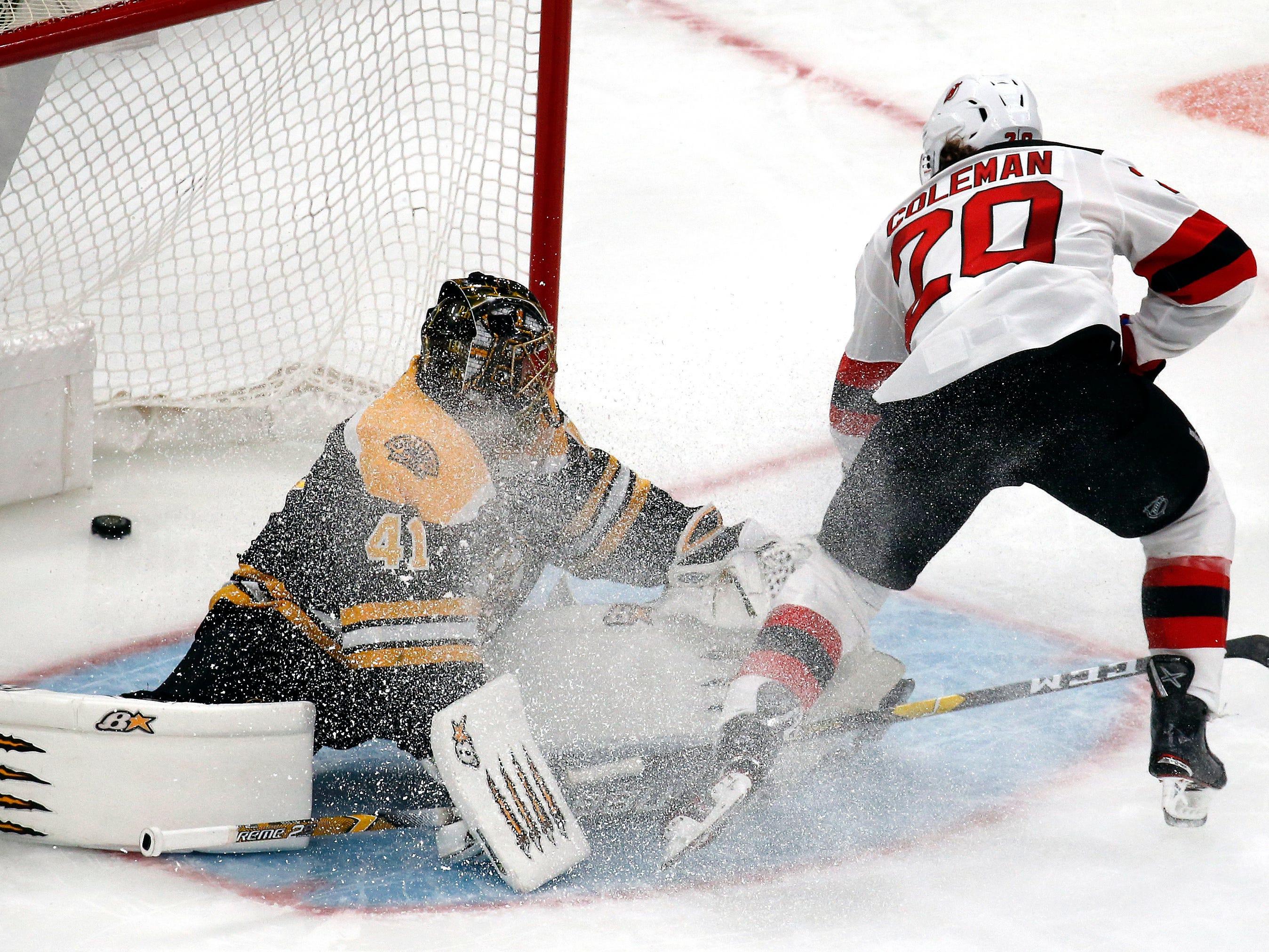New Jersey Devils center Blake Coleman (20) scores a breakaway goal against Boston Bruins goaltender Jaroslav Halak (41) during the third period of an NHL hockey game Thursday, Dec. 27, 2018, in Boston.