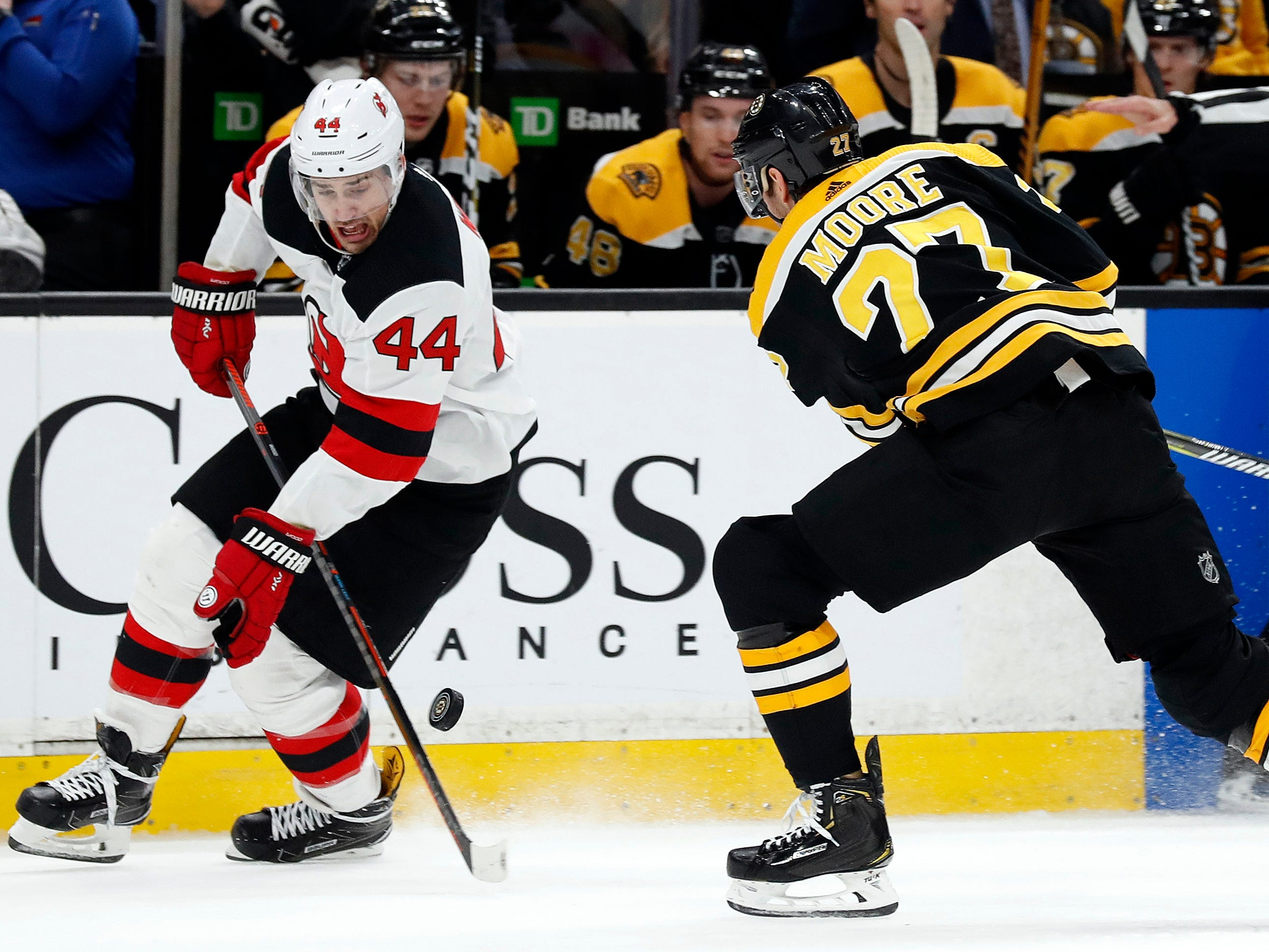 Dec 27, 2018; Boston, MA, USA; New Jersey Devils left wing Miles Wood (44) gets by Boston Bruins defenseman John Moore (27) during the first period at TD Garden.