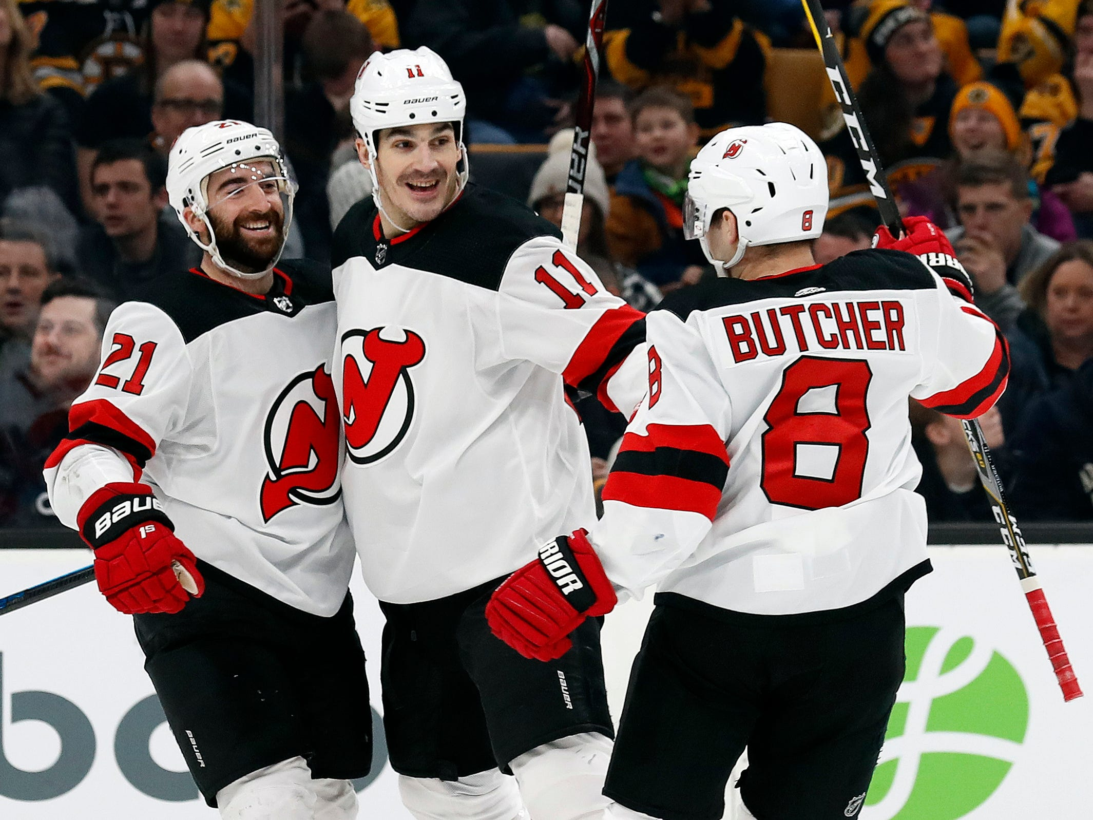 Dec 27, 2018; Boston, MA, USA; New Jersey Devils right wing Kyle Palmieri (21) celebrates his goal with center Brian Boyle (11) and defenseman Will Butcher (8) during the first period against the Boston Bruins at TD Garden.